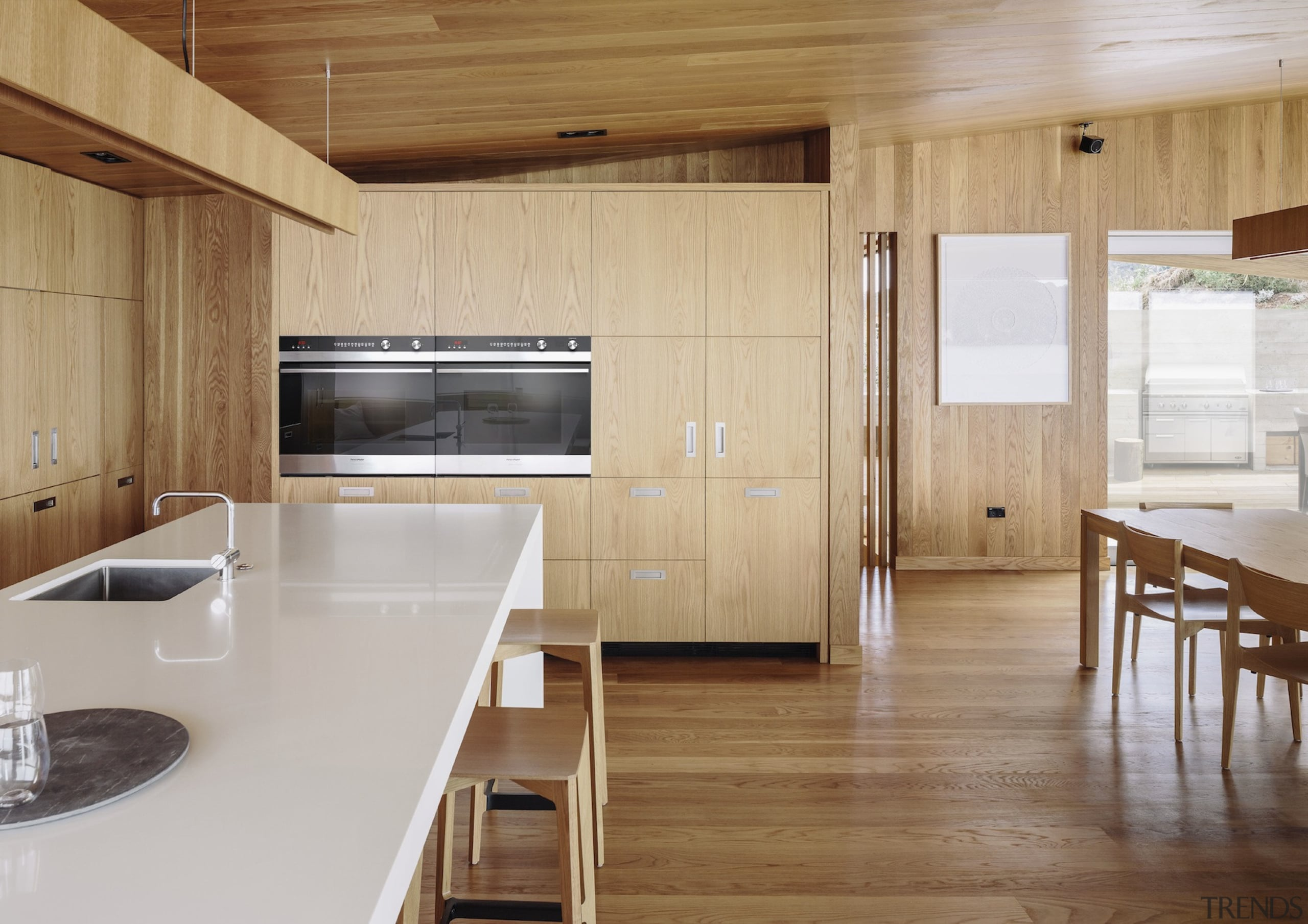 The Scandinavian-style interiors, lined with American oak, exude architecture, countertop, floor, flooring, hardwood, house, interior design, kitchen, real estate, wood, wood flooring, brown, gray