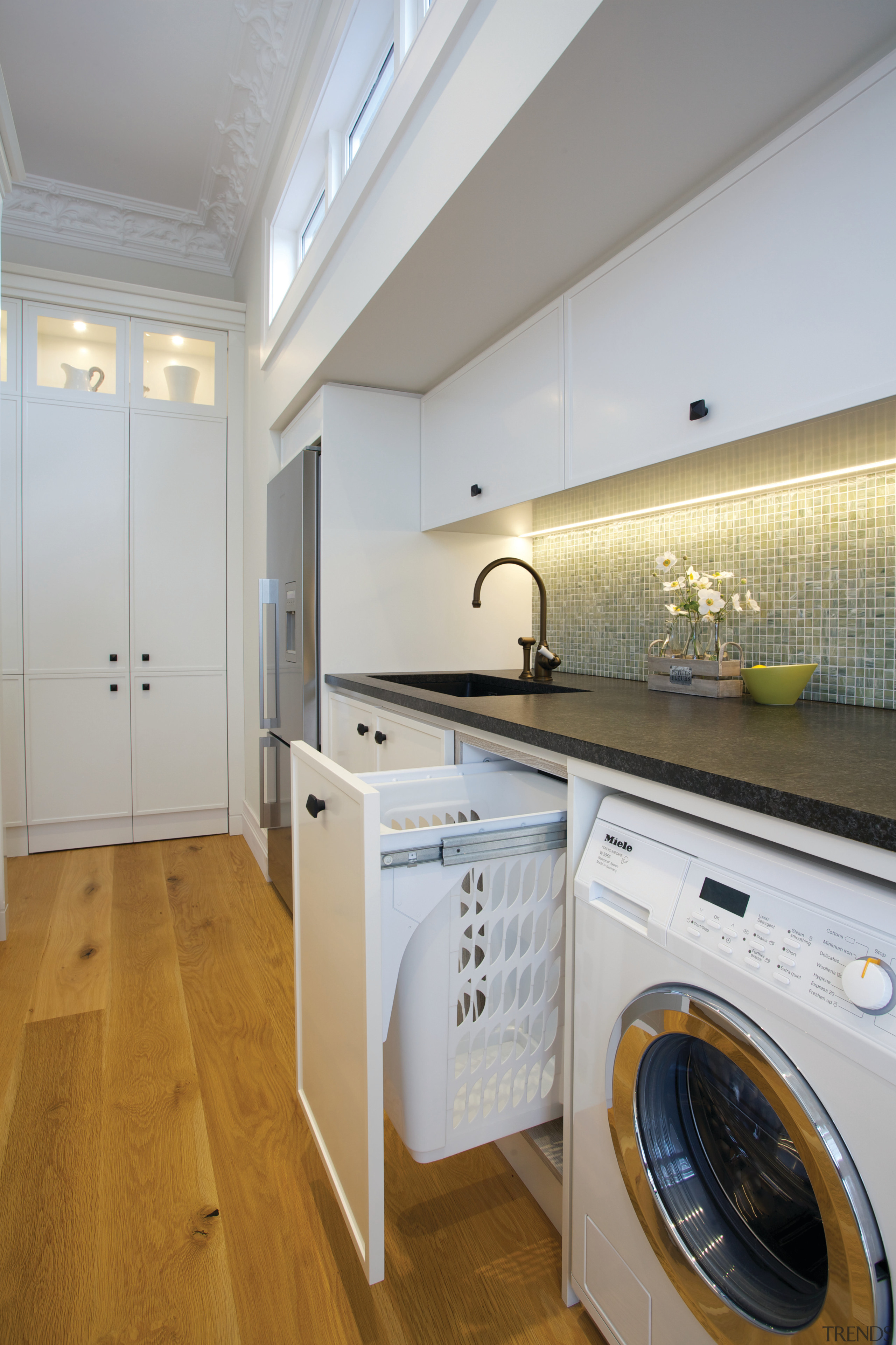 A Hideaway Laundry Hamper completes this multi-purpose space countertop, floor, interior design, kitchen, laundry room, major appliance, property, real estate, room, gray