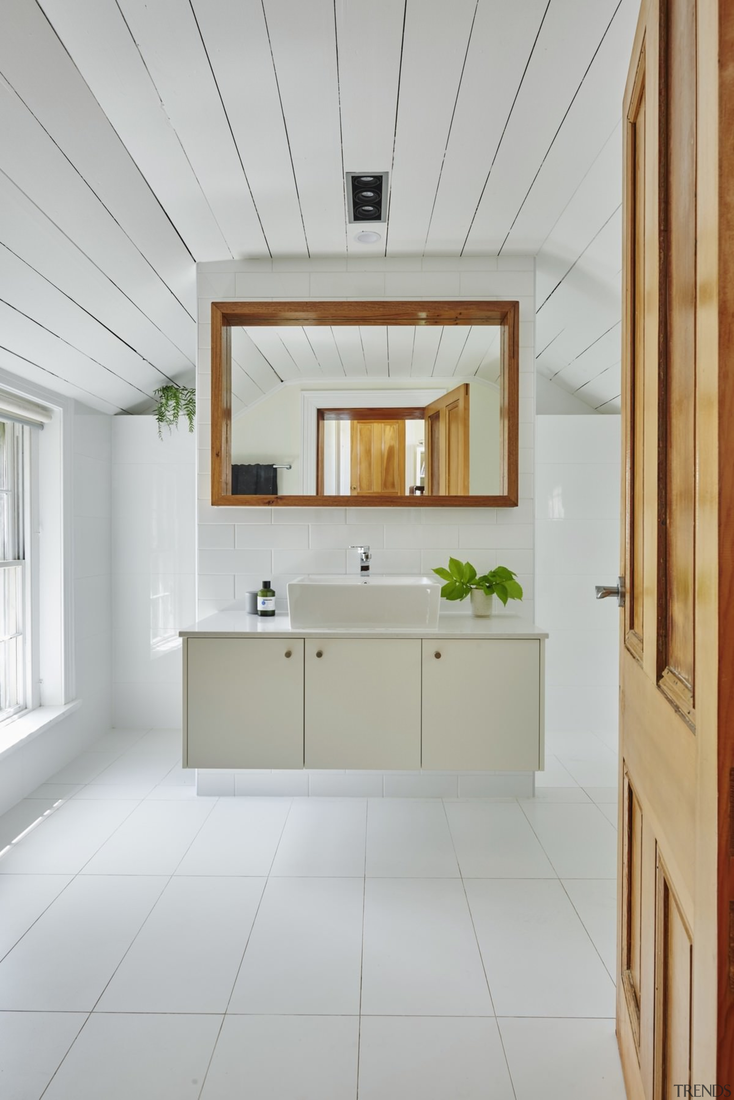 The bathroom vanity floats above the floor - architecture, ceiling, floor, flooring, home, interior design, room, window, gray