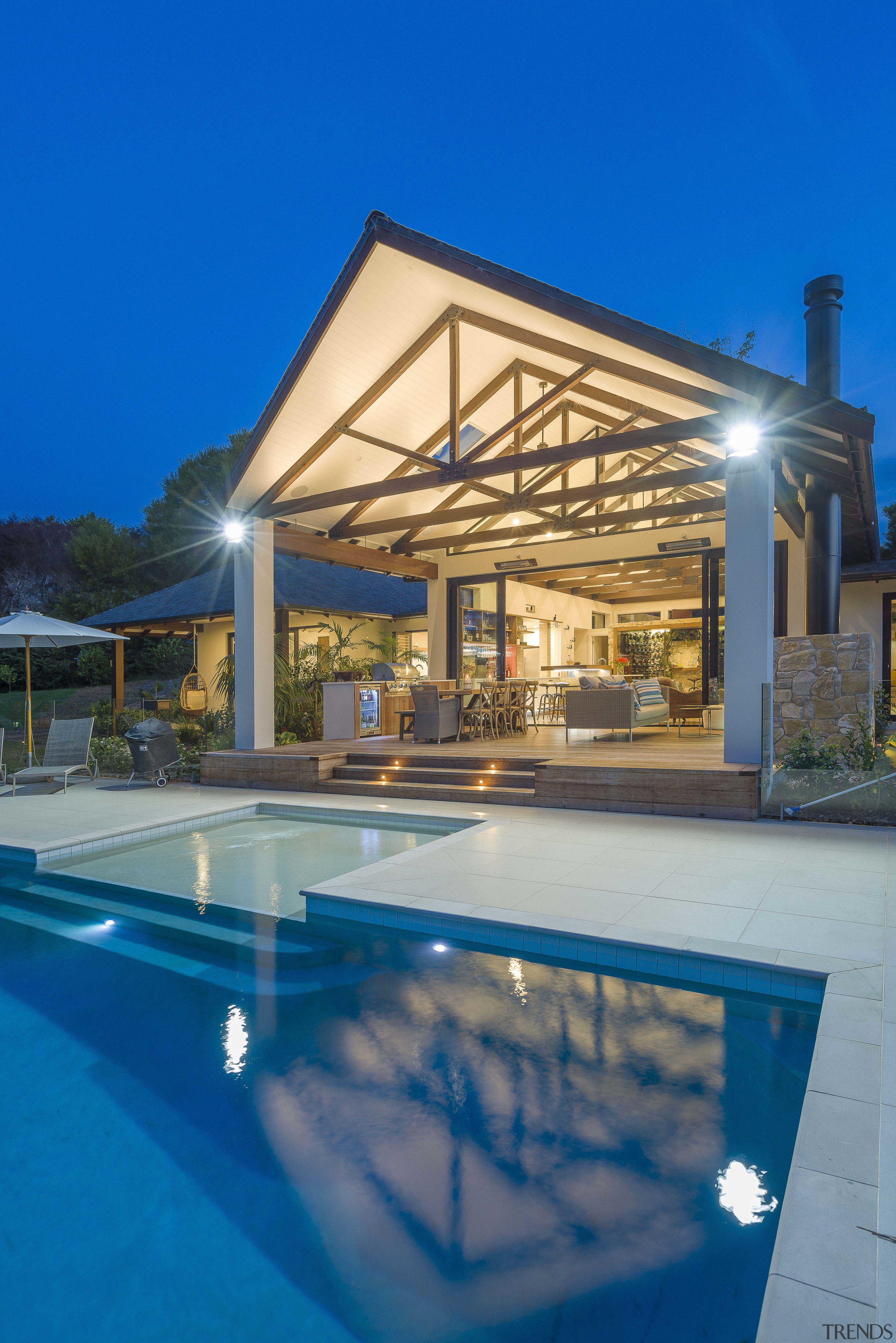 Timber ceiling beams help set the airy, tropical architecture, building, design, estate, home, house, leisure, lighting, patio, property, real estate, resort, roof, shade, swimming pool, villa, blue