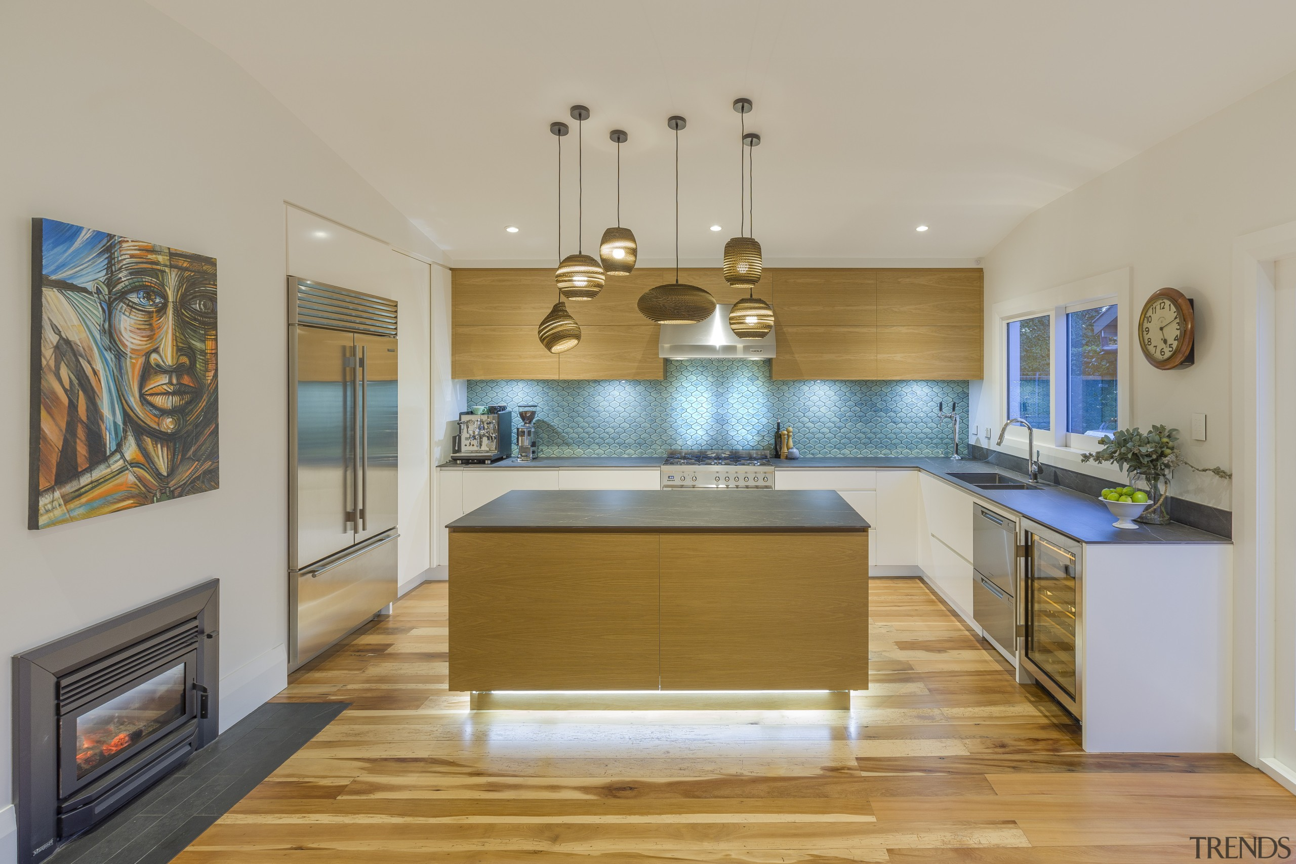 The iridescent splashback draws the eye in this architecture, building, cabinetry, ceiling, countertop, dining room, estate, floor, flooring, furniture, hardwood, home, house, interior design, kitchen, light fixture, property, real estate, room, wood, wood flooring, yellow, gray