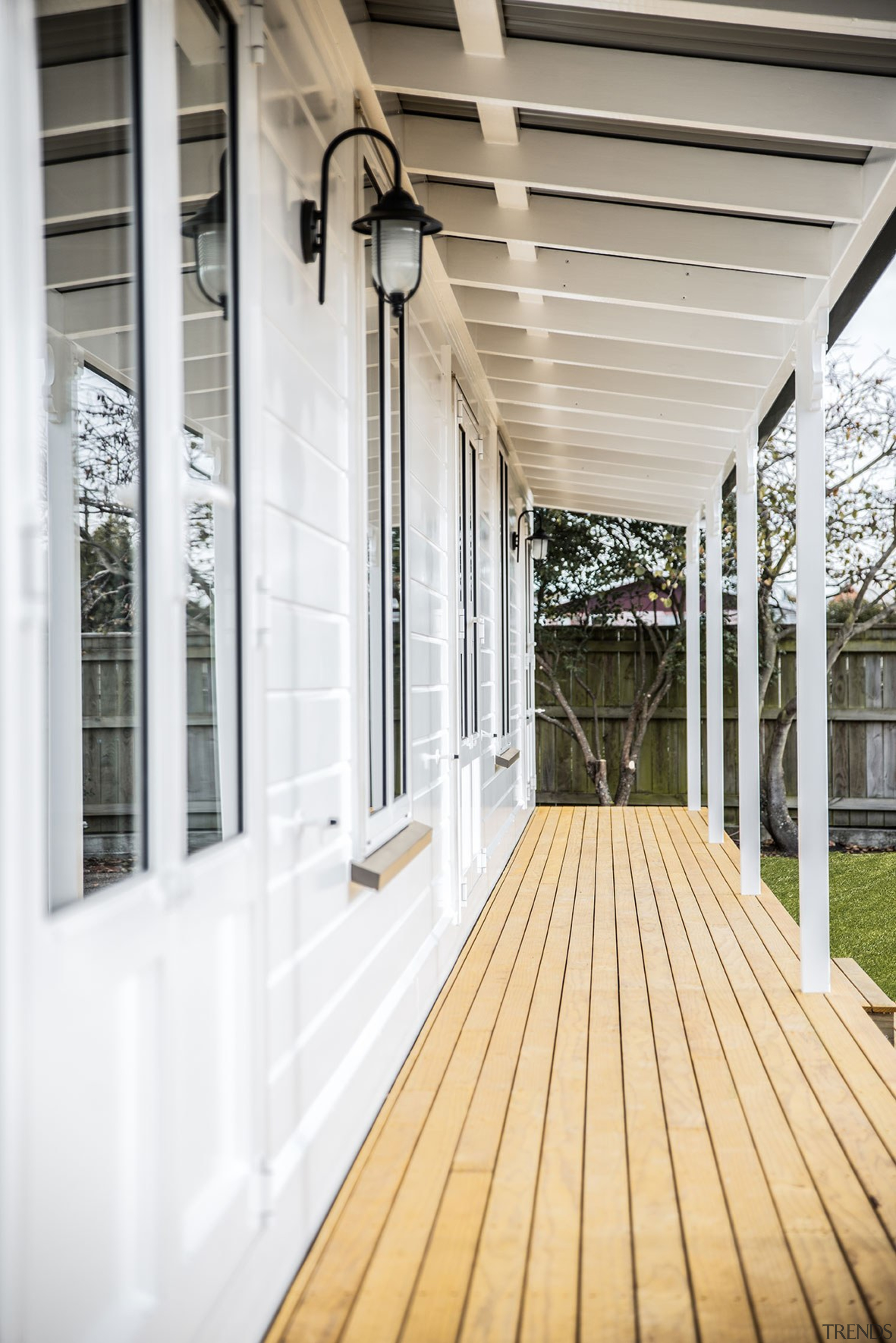 Finish A Porch With Niagara Laminated Timber Posts daylighting, deck, floor, flooring, house, outdoor structure, porch, siding, structure, window, wood, white, gray