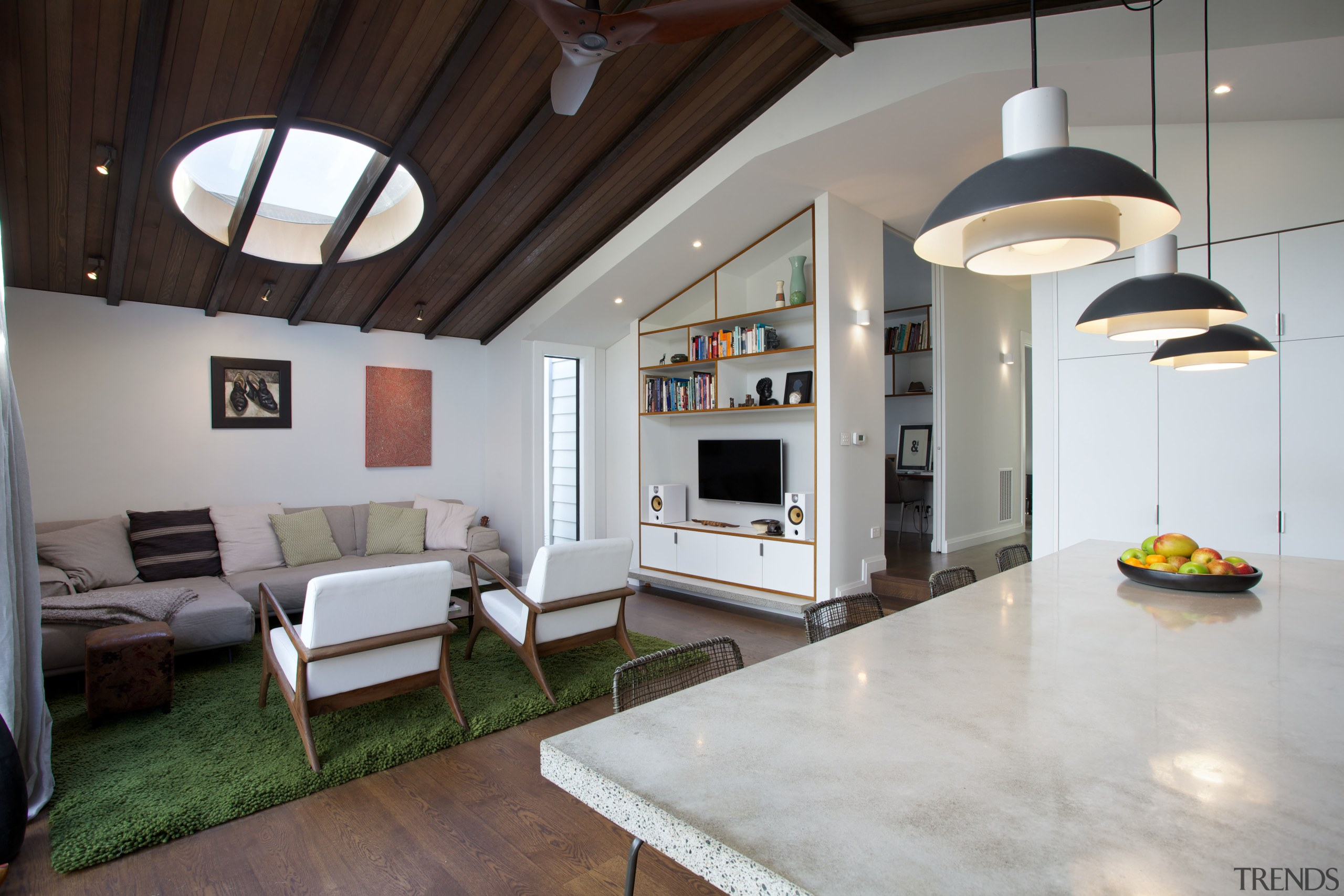 In this renovated villa, steps lead down to ceiling, floor, house, interior design, living room, loft, real estate, gray