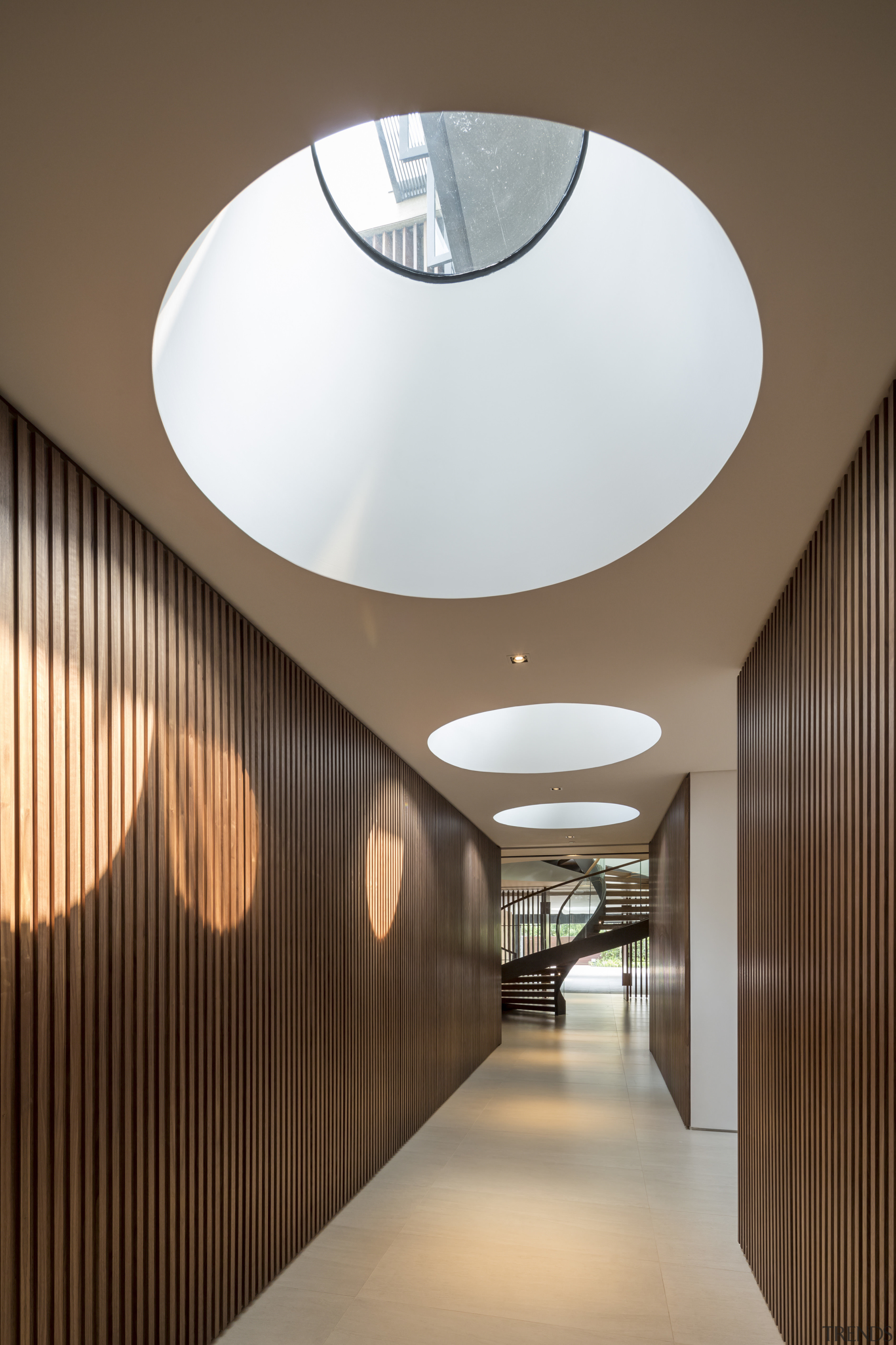 Skylights in this basement level corridor ensure that architecture, ceiling, daylighting, house, interior design, light fixture, lighting, lobby, product design, brown