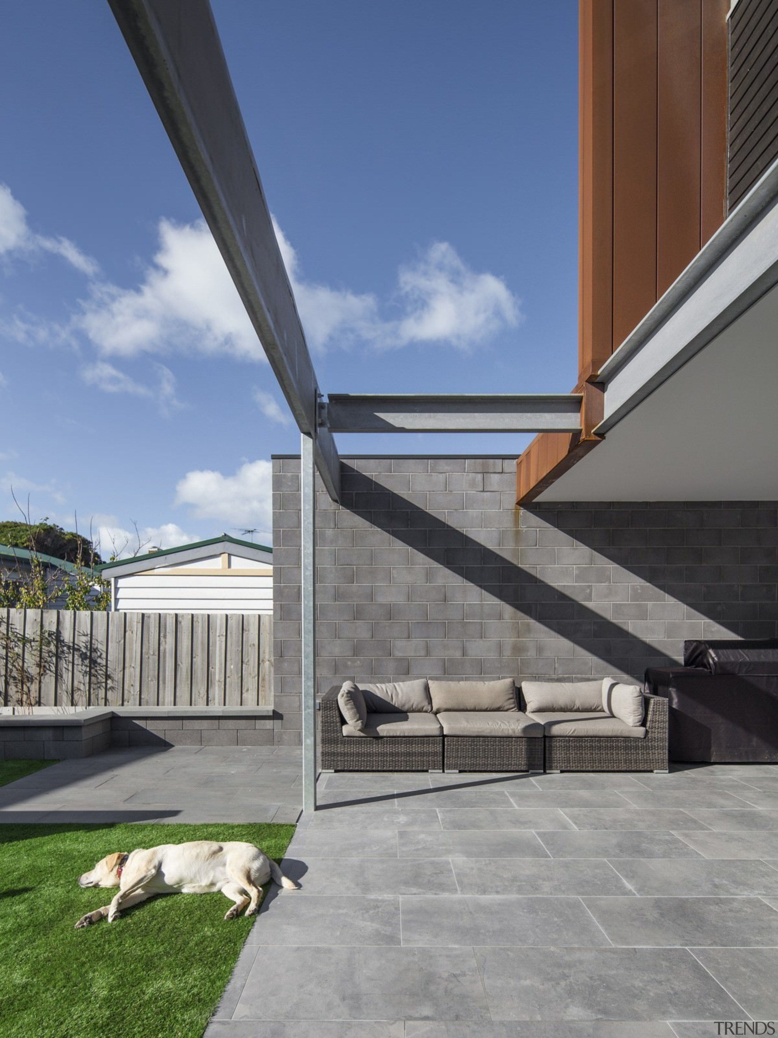 This comfortable outdoor area extends out from the architecture, building, daylighting, house, roof, sky, structure, gray