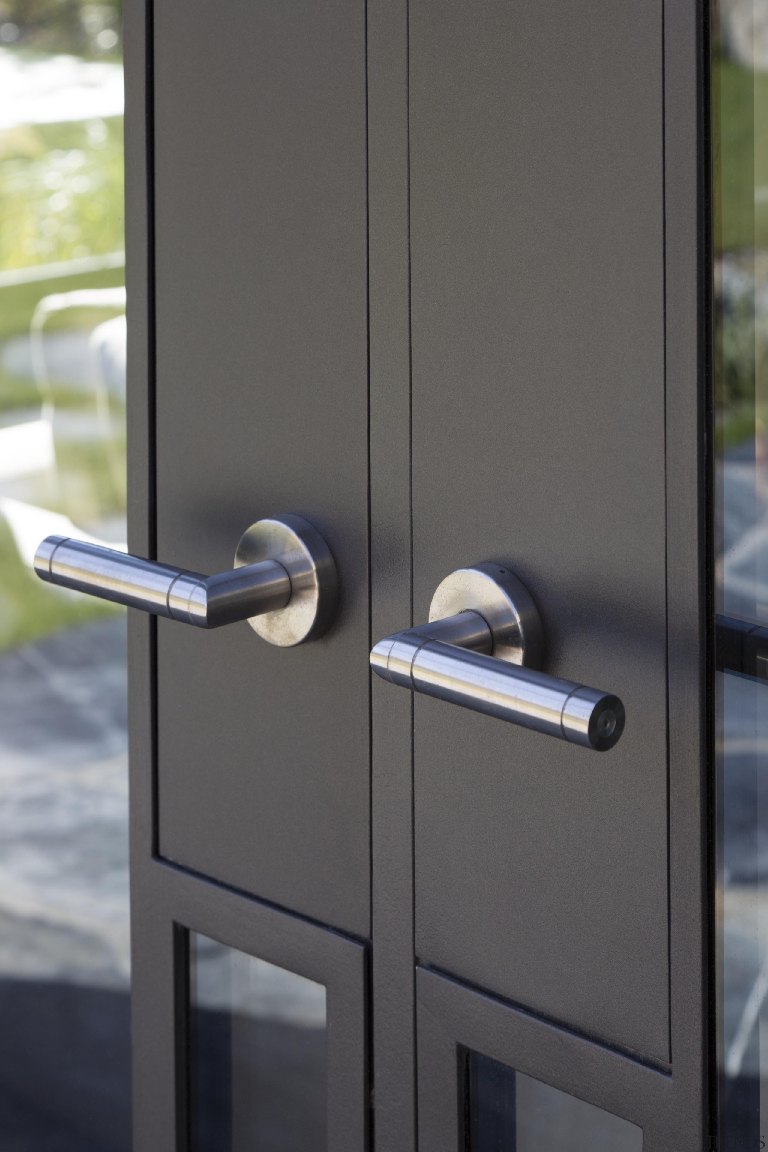 Handles for this Millbrook Resort home were custom-made door, lock, gray