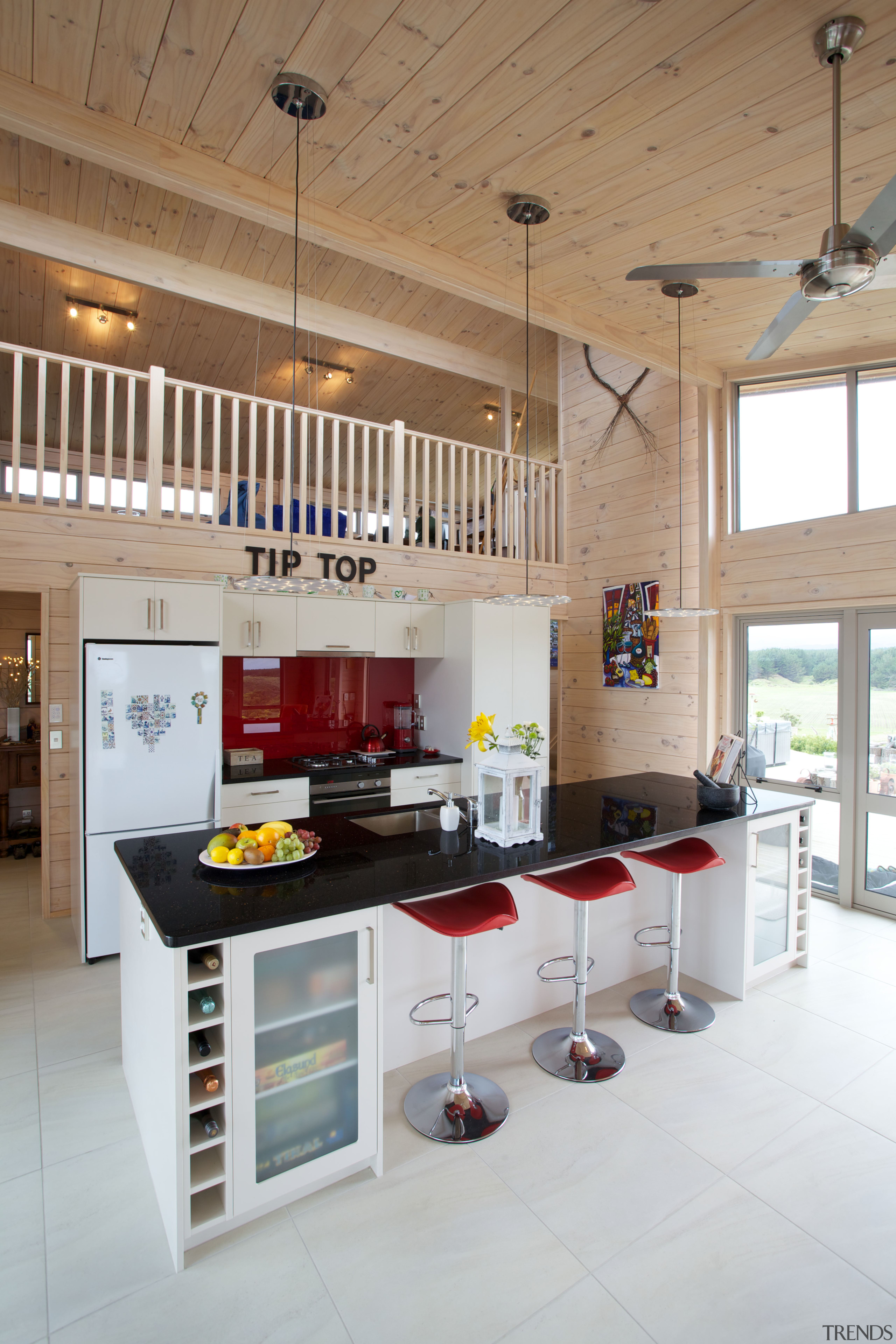 The owners of this Lockwood beach house chose countertop, interior design, kitchen, table, gray, brown, white