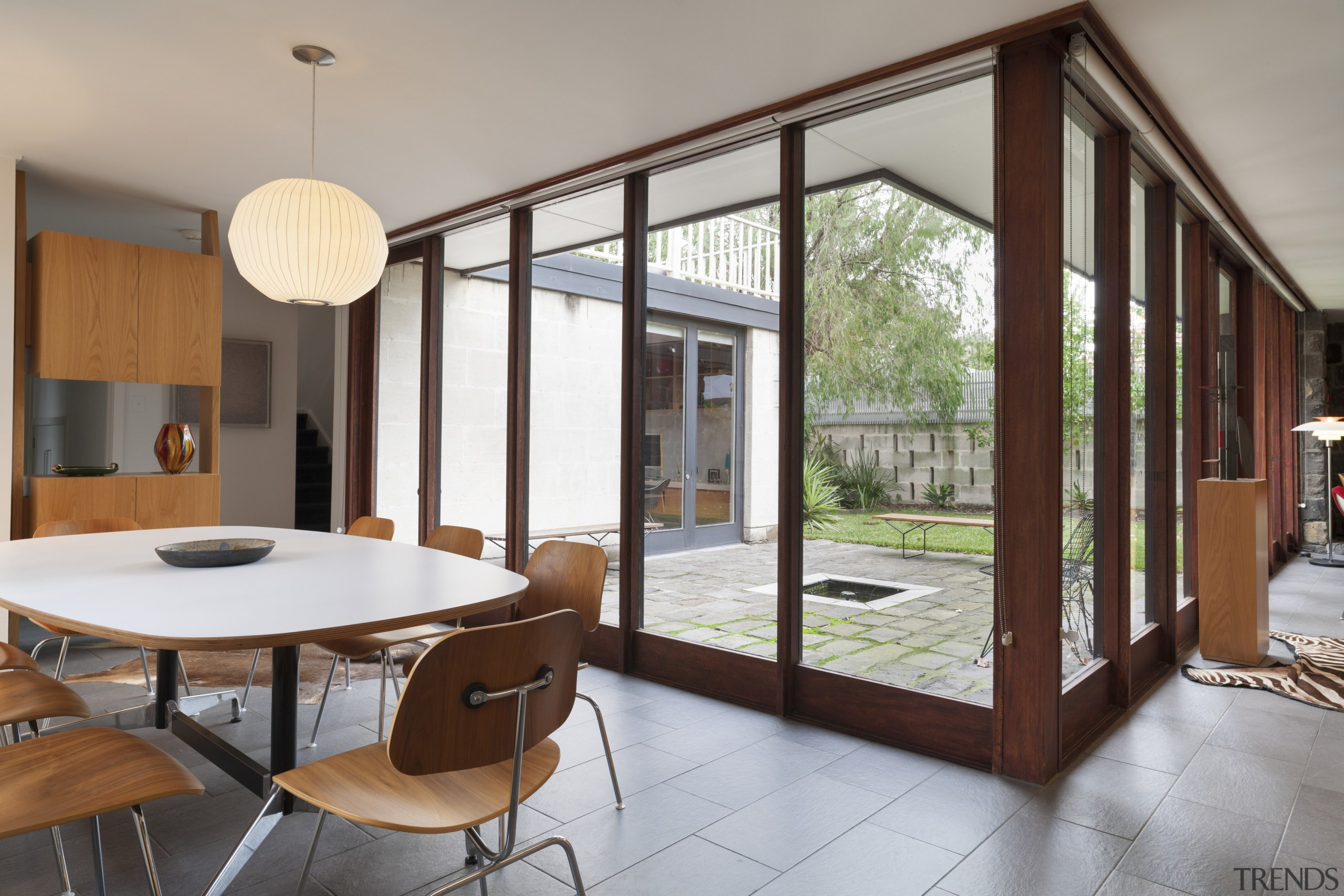 As part of a renovation of this Mid-century architecture, door, house, interior design, real estate, window, gray