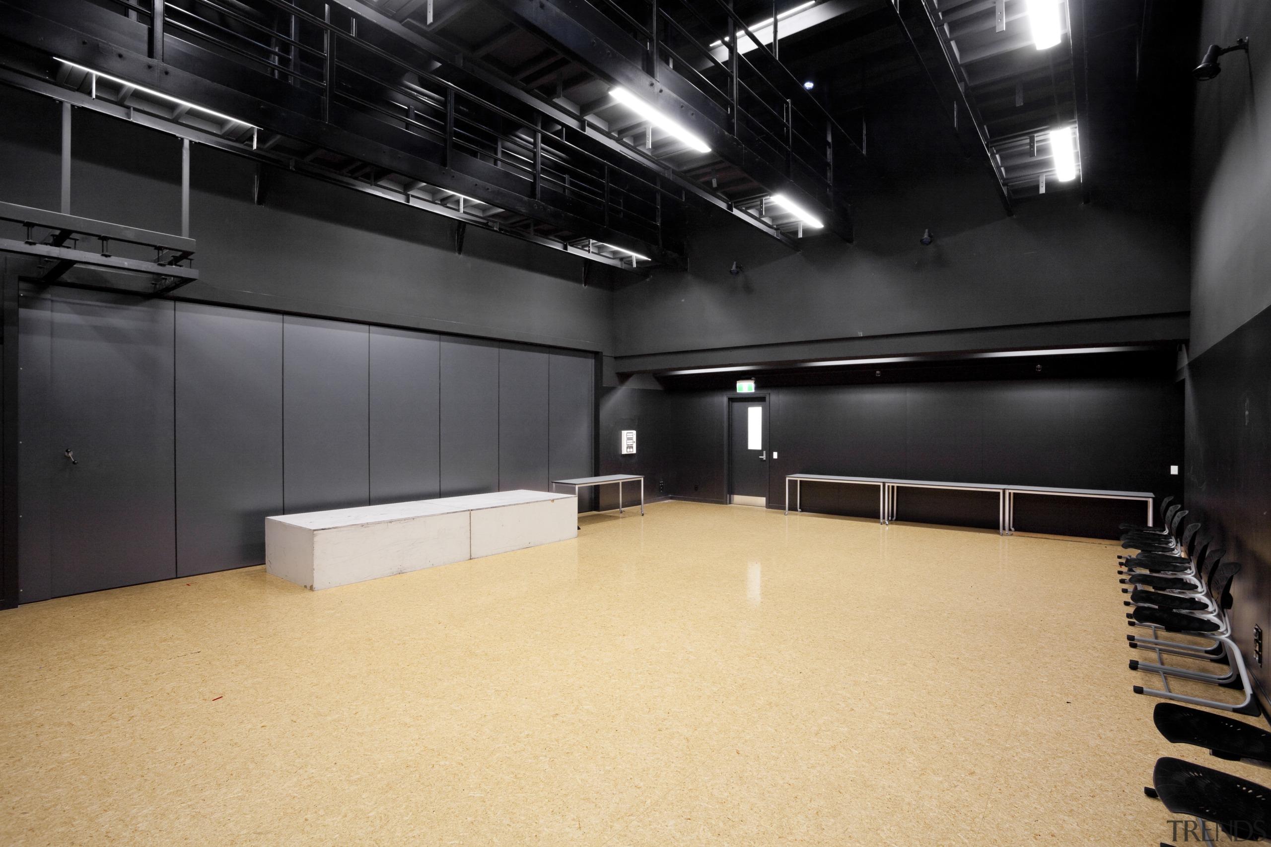 View of room with black walls and ceiling auditorium, ceiling, floor, flooring, interior design, black, orange