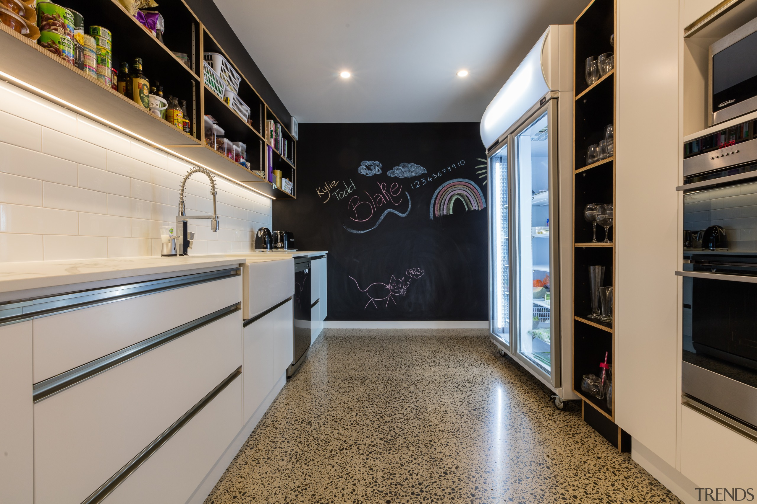 A blackboard  wall at the end of interior design, kitchen, room, gray, black