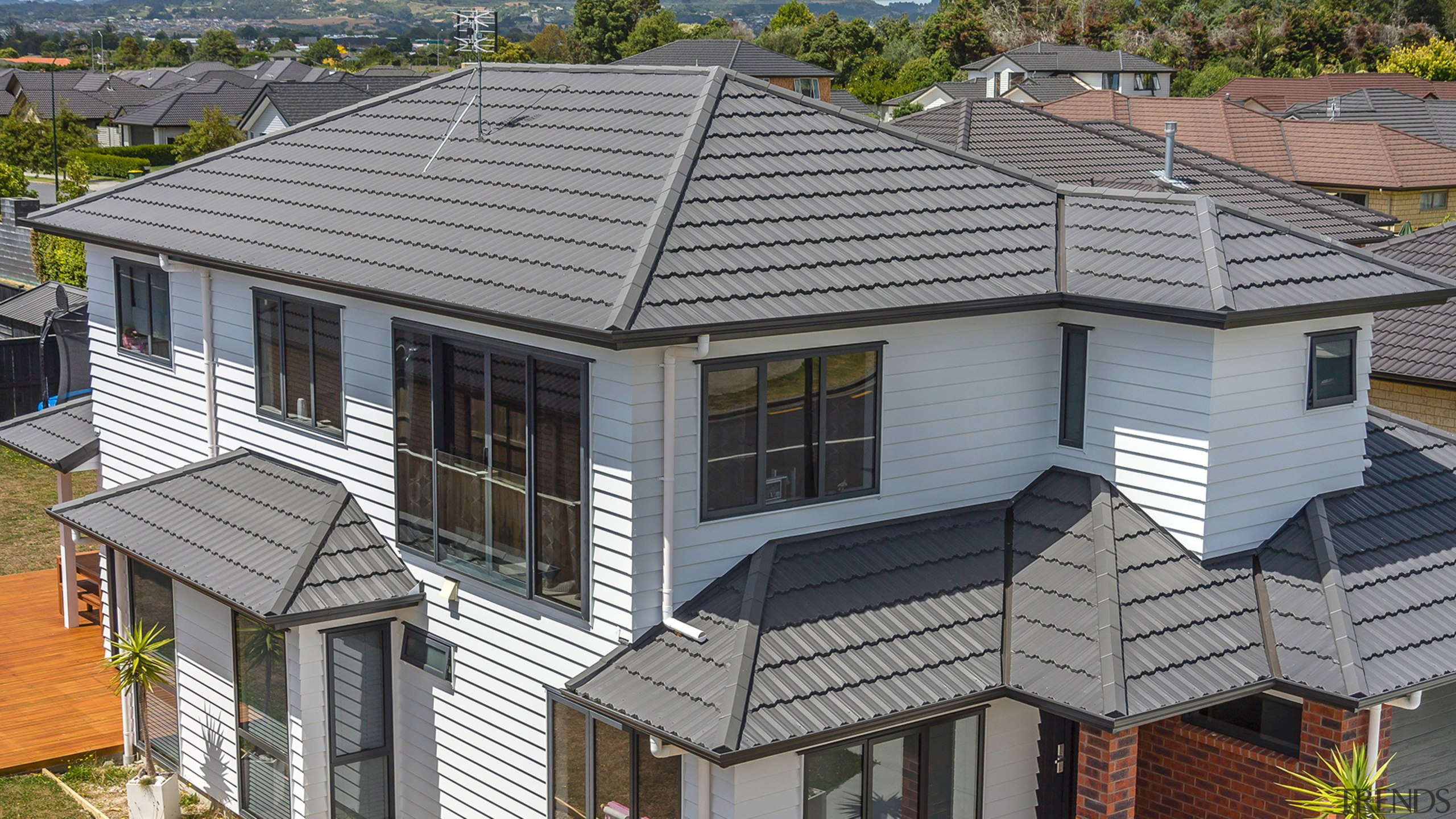 22 - building | elevation | facade | building, elevation, facade, home, house, neighbourhood, outdoor structure, property, real estate, residential area, roof, siding, gray