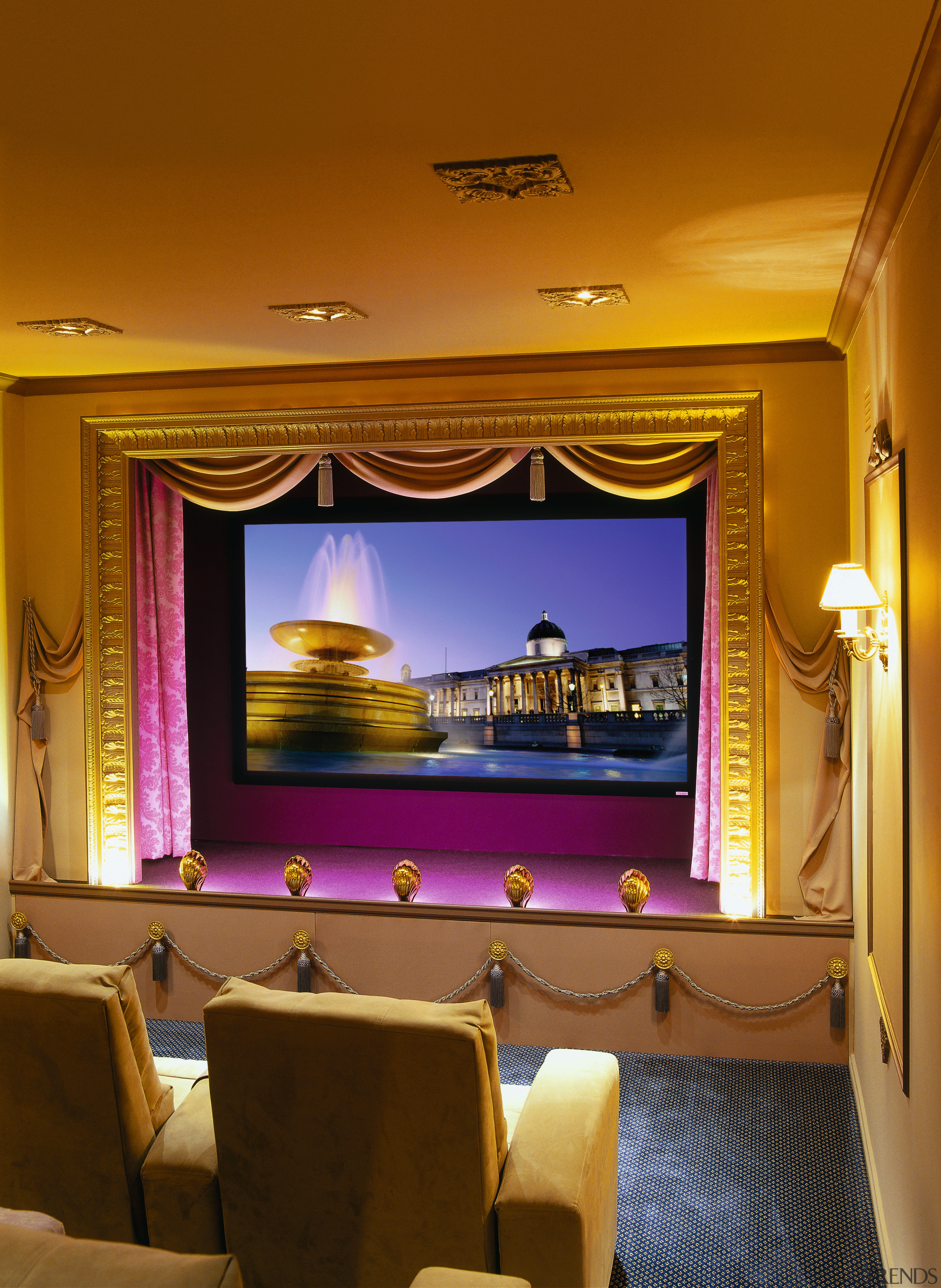 View of a home theatre, blue carpet, cream ceiling, entertainment, function hall, interior design, lighting, room, wall, brown