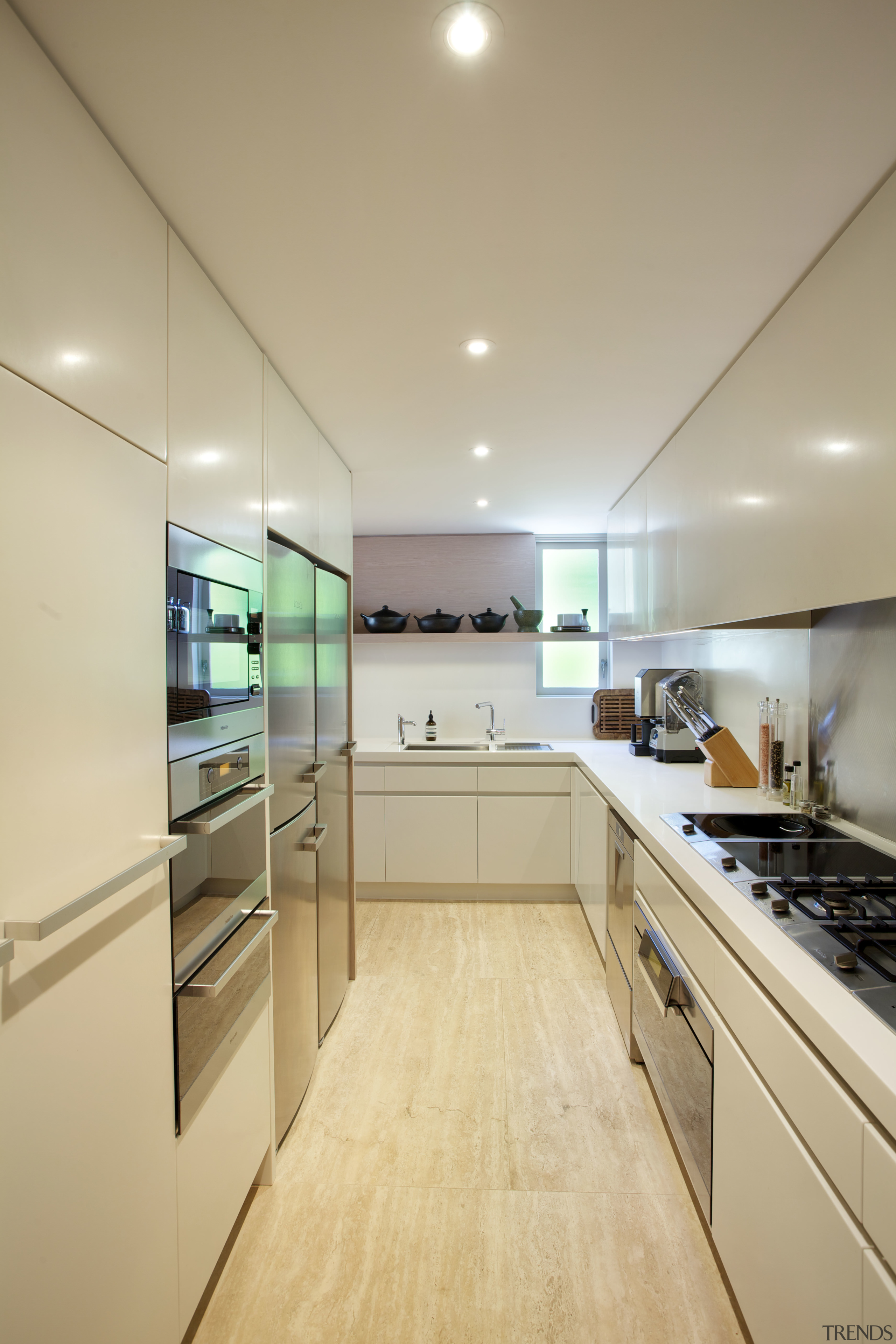 A second kitchen in this renovated house runs cabinetry, ceiling, countertop, cuisine classique, interior design, kitchen, real estate, room, orange