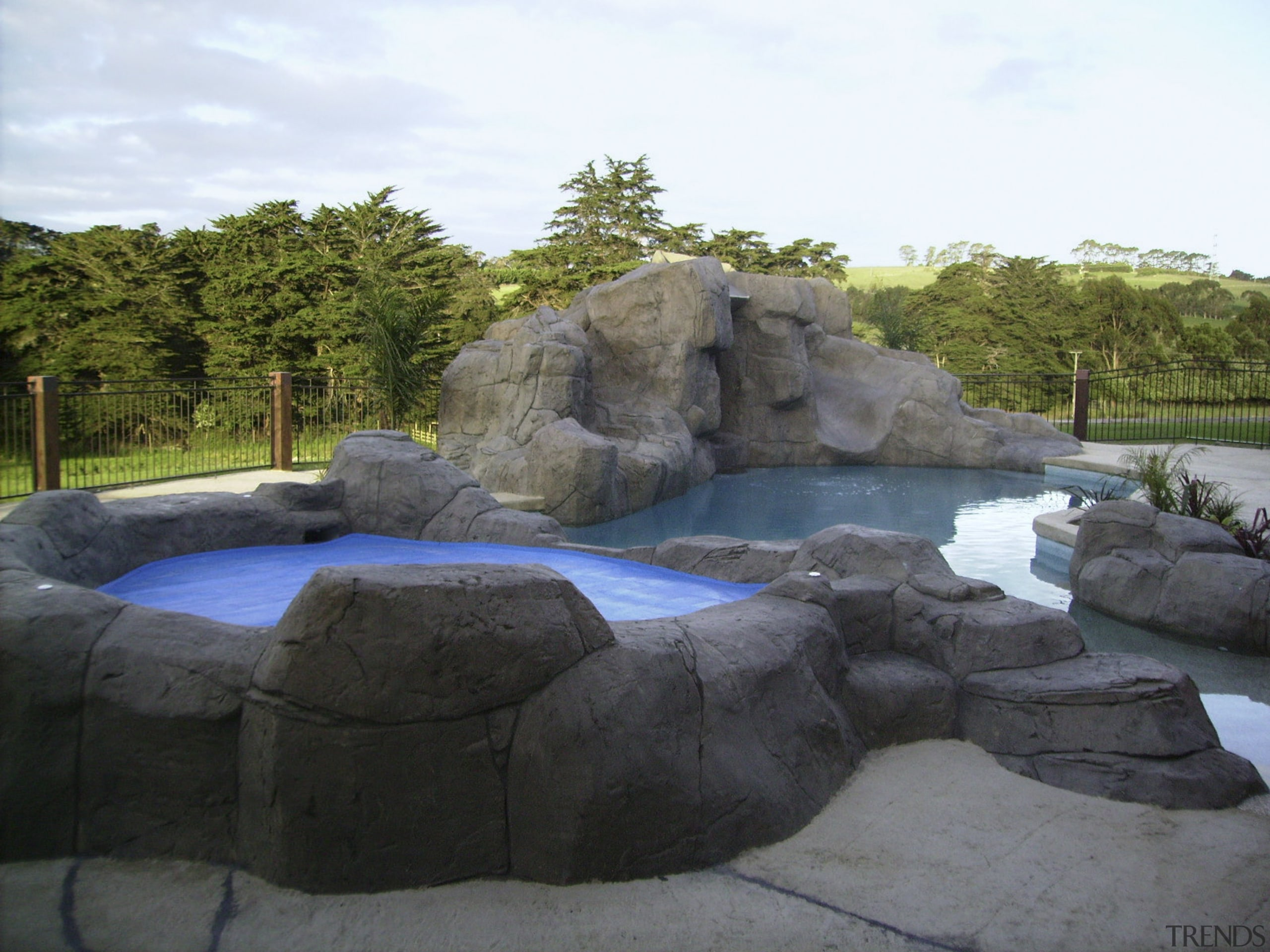 Natural looking pool & spa area - Natural landscape, pond, rock, swimming pool, water, water feature, water resources, watercourse, black, white