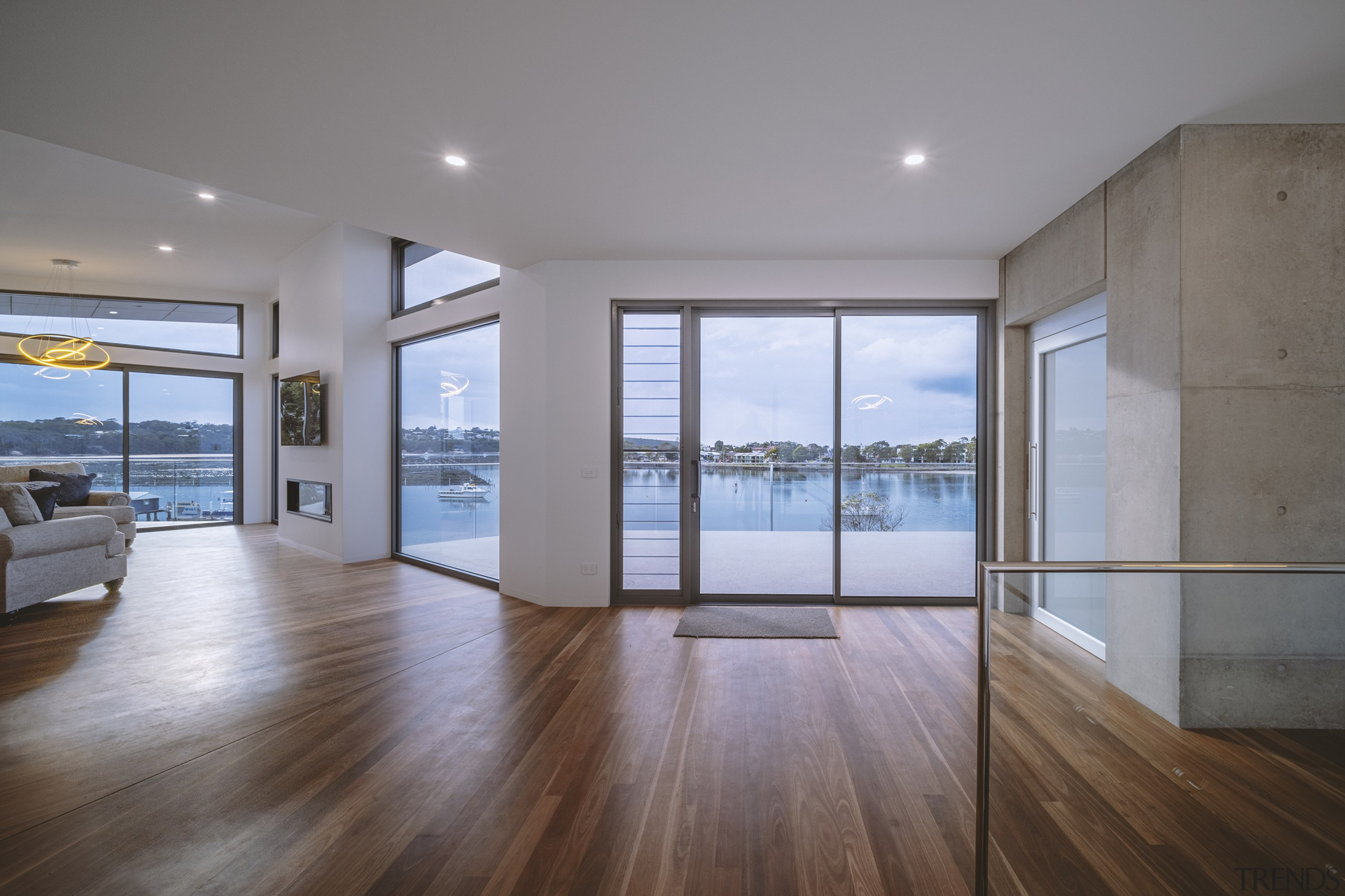The exposed raw concrete and timber flooring make