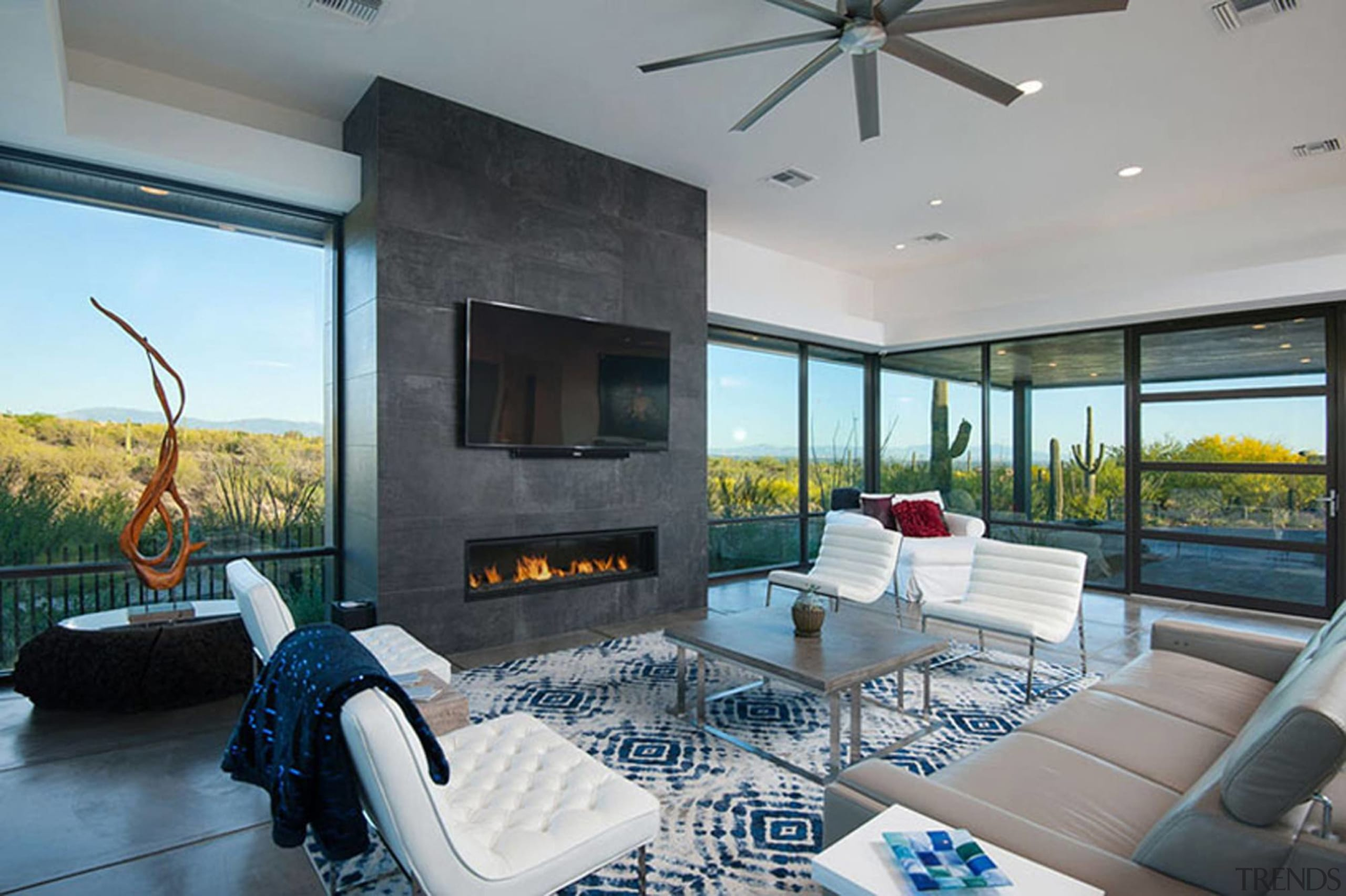 The TV sits above the fireplace facing the estate, house, interior design, living room, property, real estate, window, gray