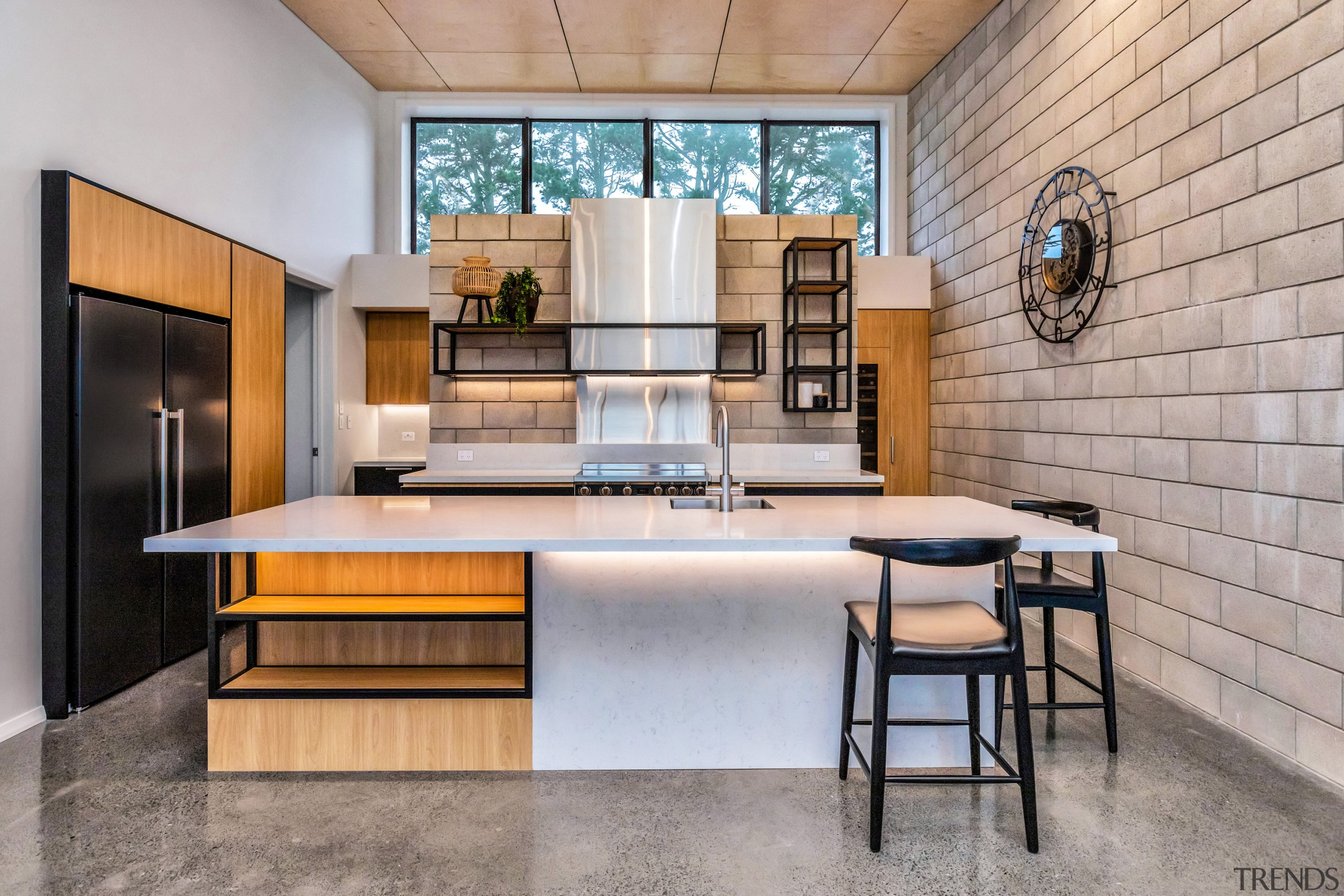 A cinder block wall separating the kitchen and