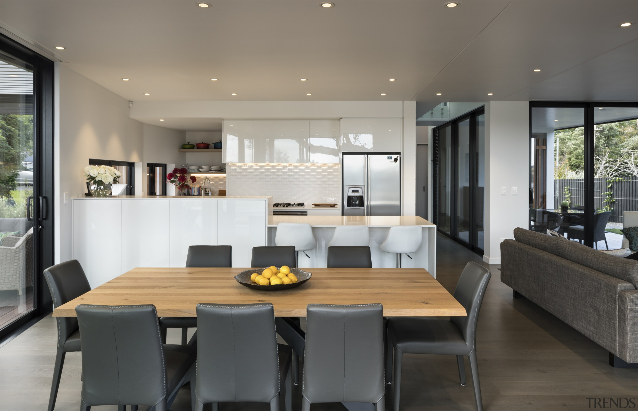 Kitchen and dining link to outdoor areas. - dining room, house, interior design, kitchen, living room, real estate, table, gray, black