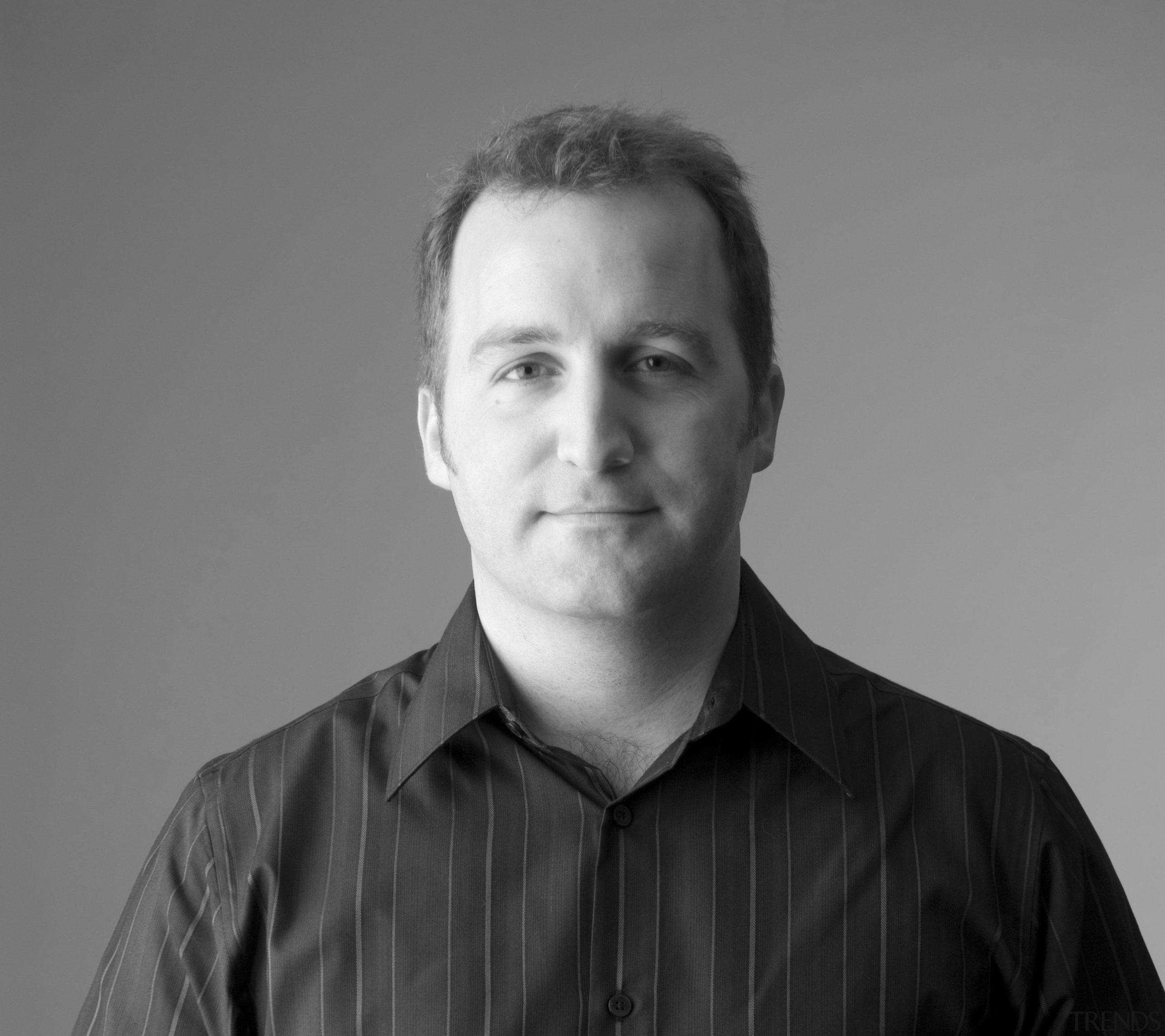 Senior principal of global architecture company Populous Tom gentleman, monochrome, photography, portrait, sitting, gray, black