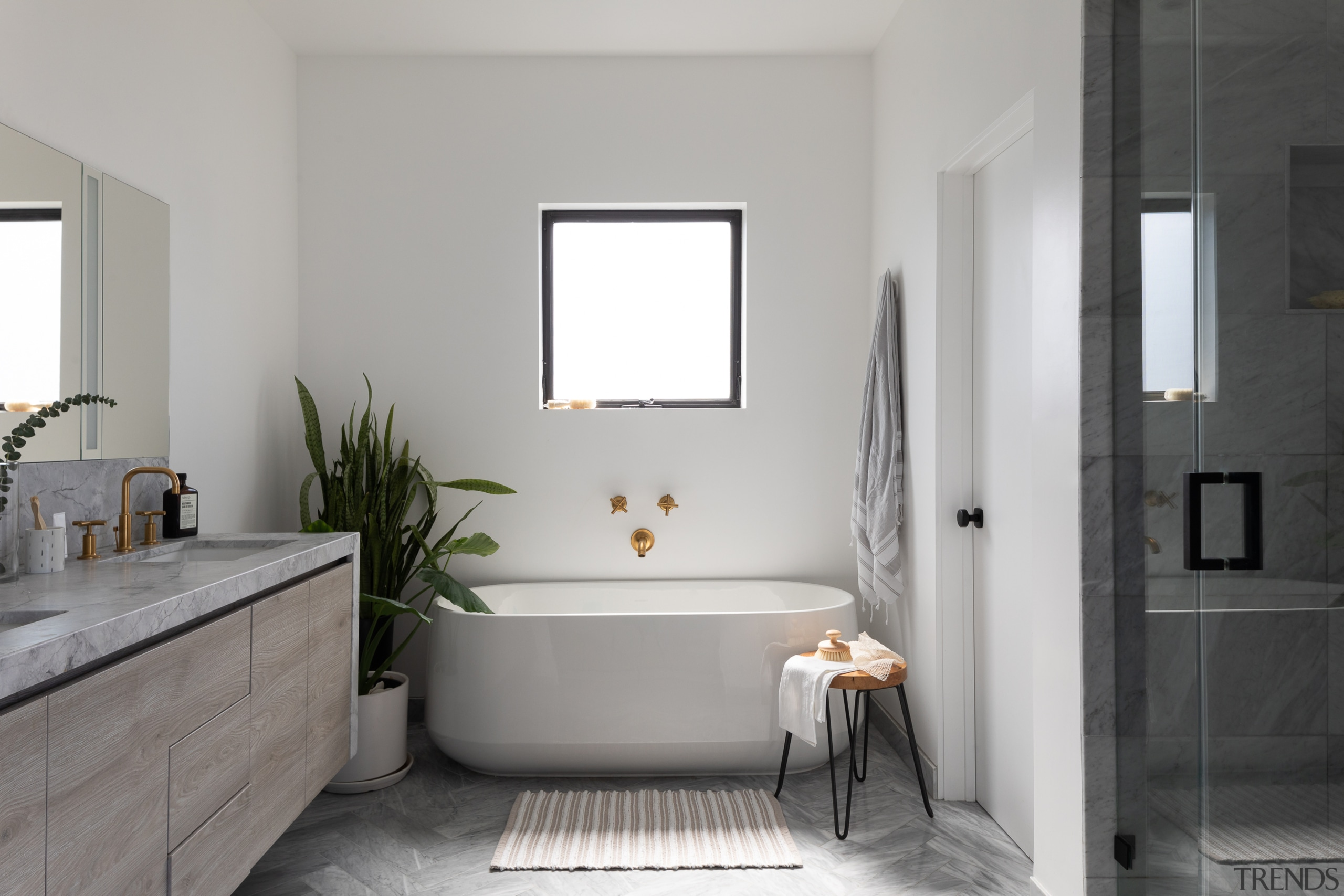 The plumbing fixtures float against the simple white