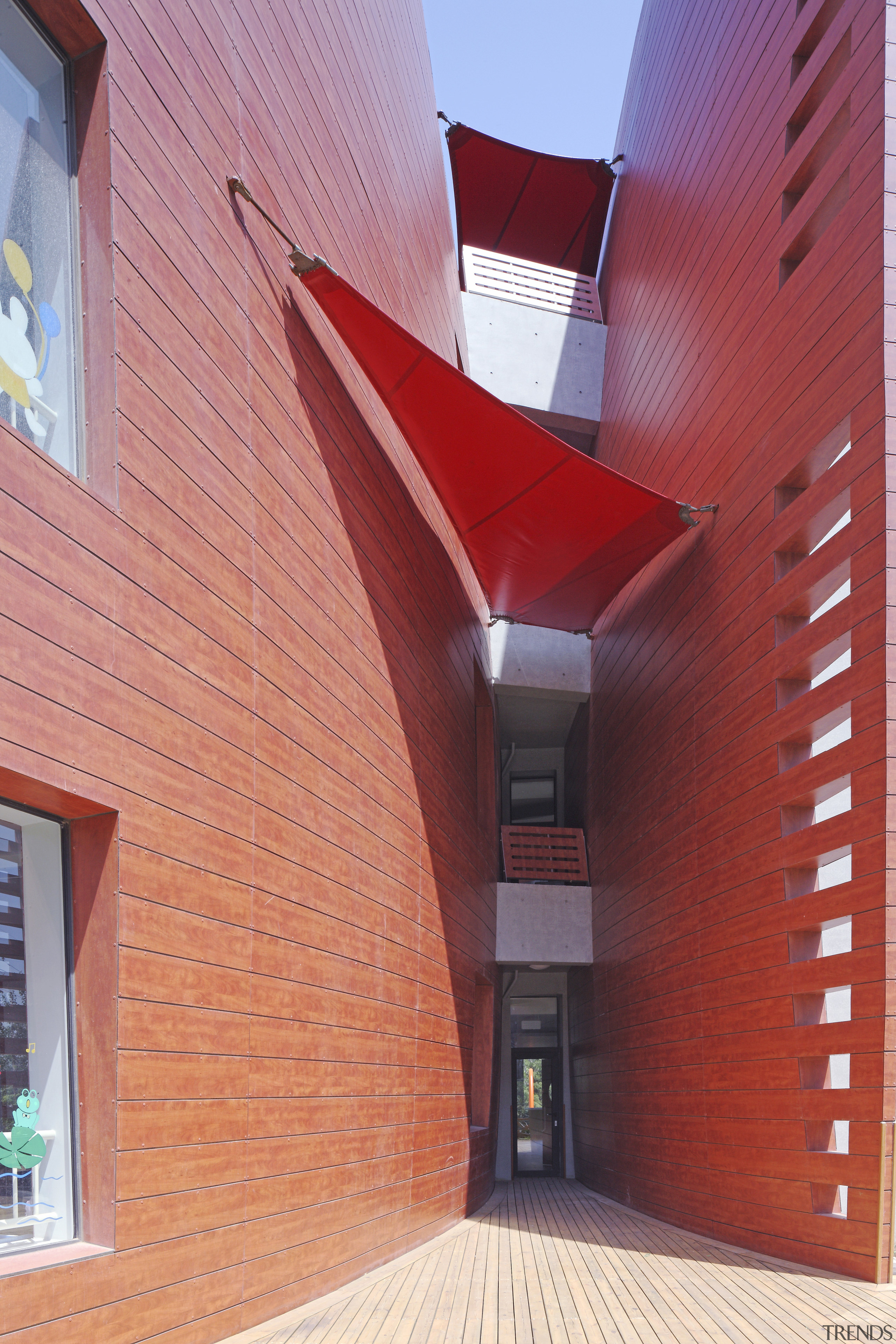 View of Dalian Preschool, with curvilinear forms and architecture, brick, building, ceiling, daylighting, facade, house, real estate, wall, red