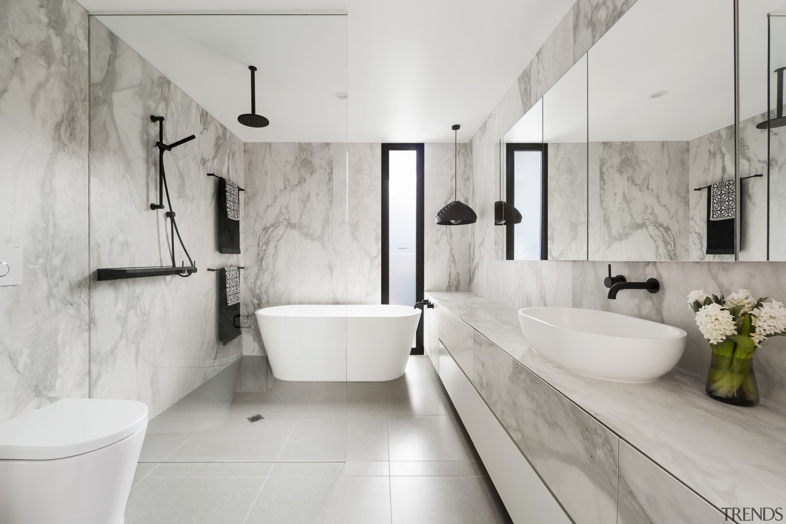 Project architect Linda Simons of LSA Architects created architecture, bathroom, tiled floor, home, bathroom design, plumbing fixture, tap, marble, freestanding bath, LSA Architects