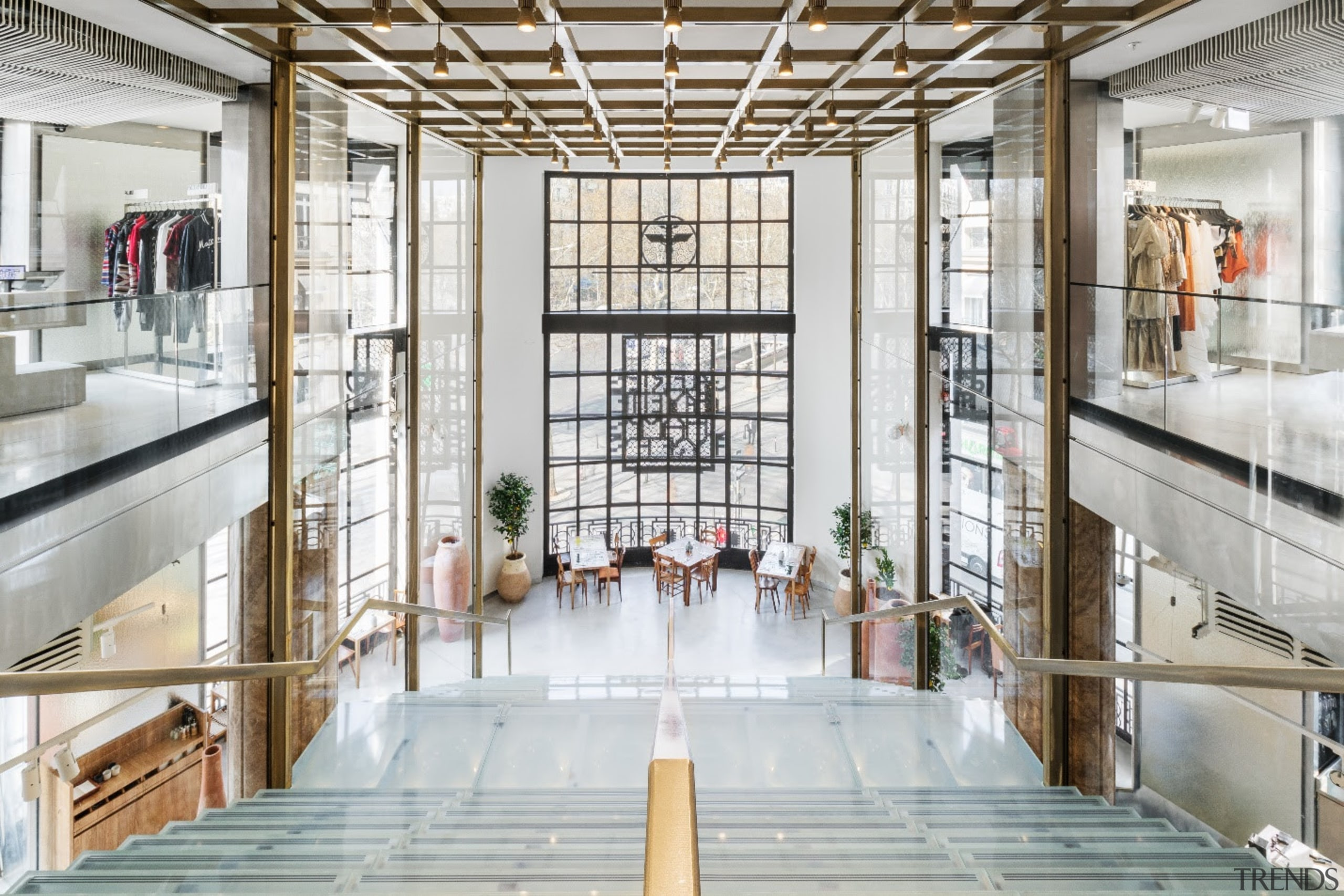 The historical architecture is supplemented by the raw architecture, building, ceiling, daylighting, glass, interior design, lobby, window, white, gray
