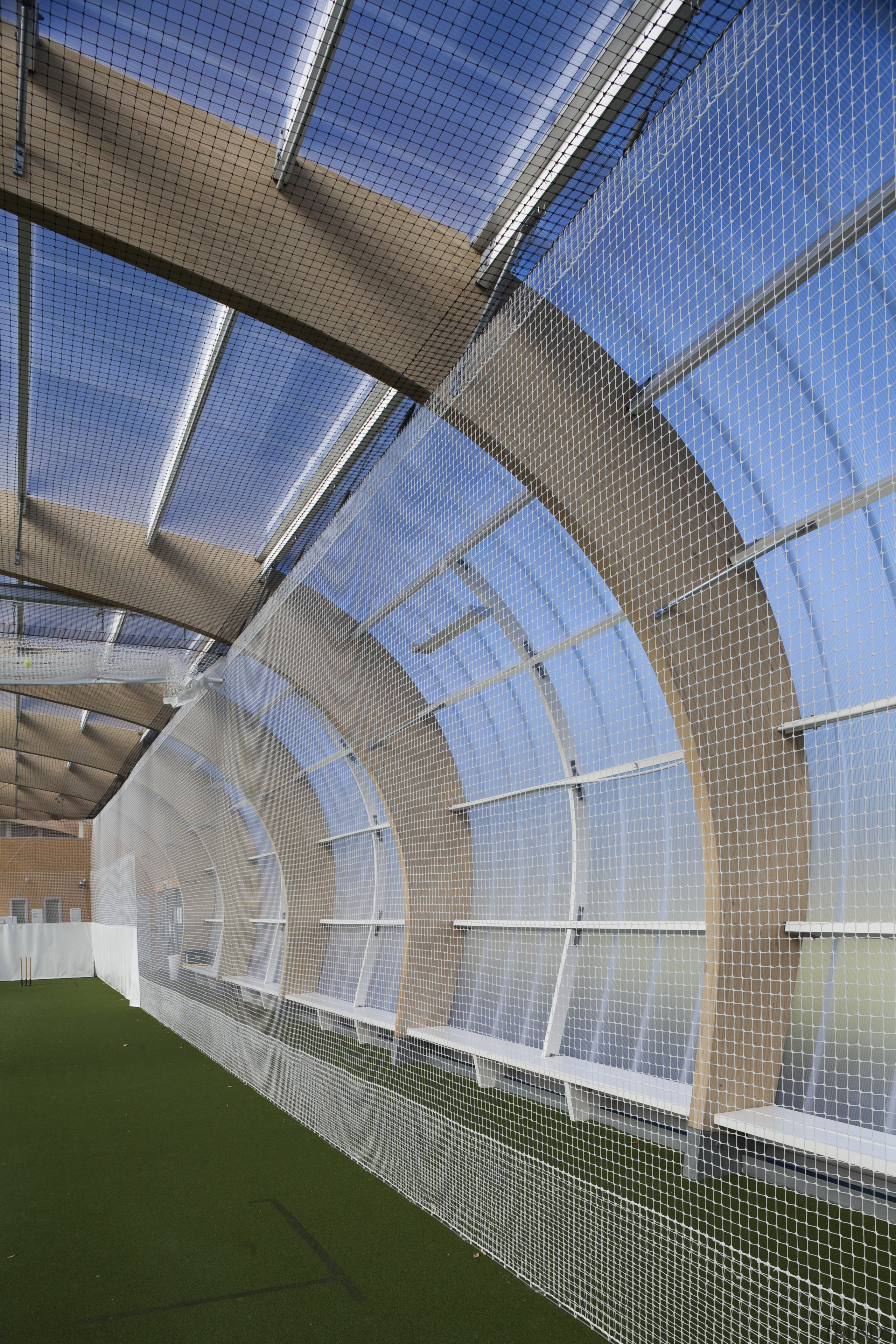 Detail of curved roof. - Detail of curved architecture, atmosphere of earth, daylighting, daytime, facade, headquarters, line, net, sky, sport venue, stadium, structure, gray