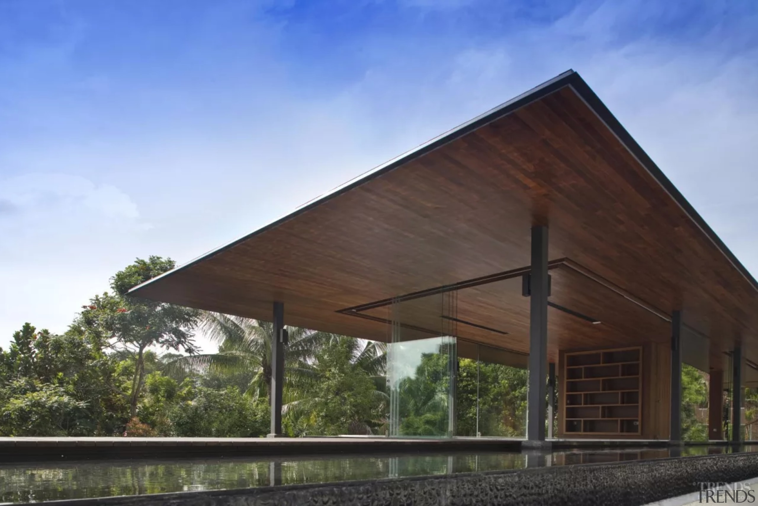 Water surrounds all sides of this living pavilion architecture, barn, building, facade, farmhouse, home, house, property, real estate, roof, rural area, shade, sky, tree, teal, black