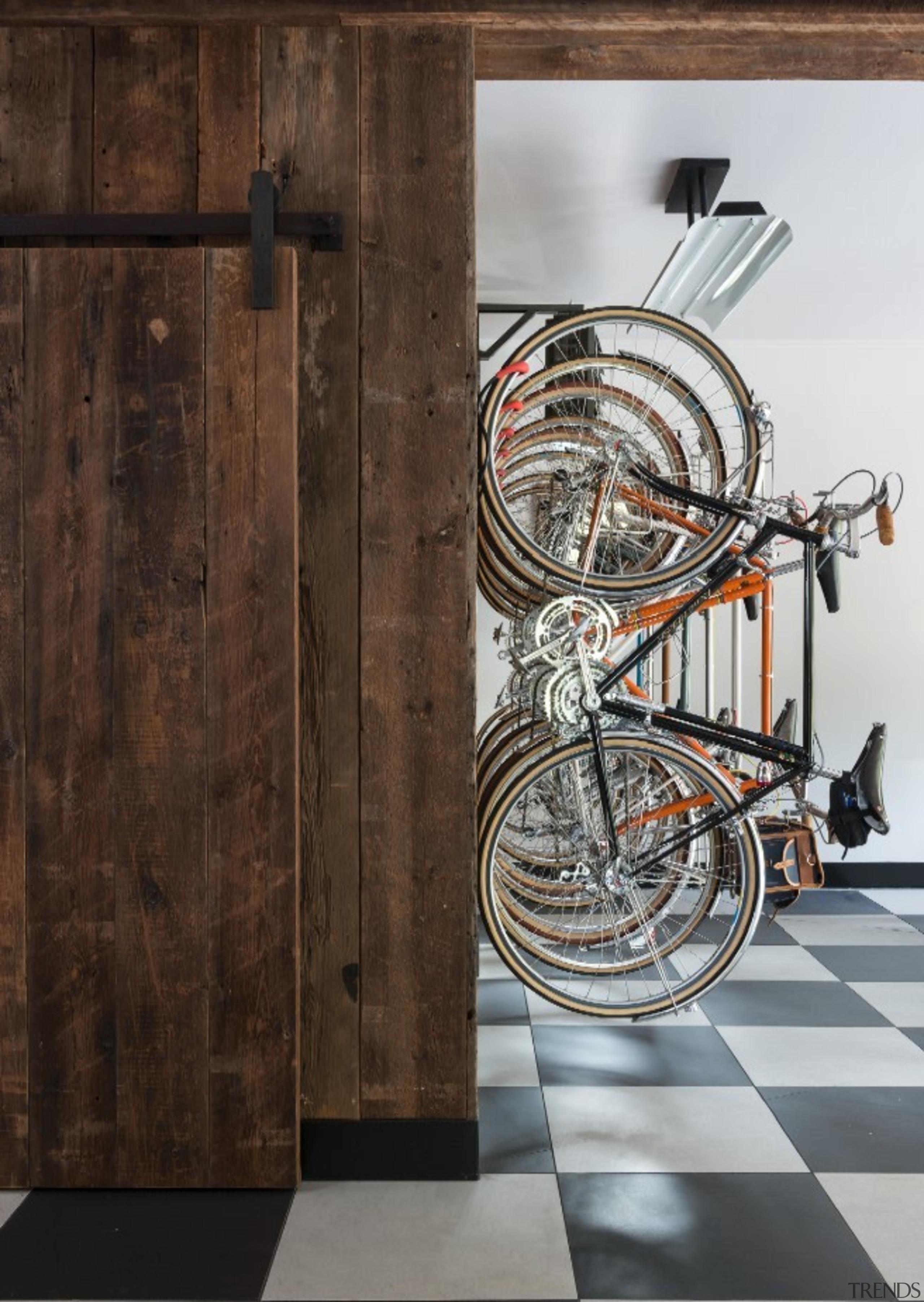 Bike storage runs along this wall above a wall, brown