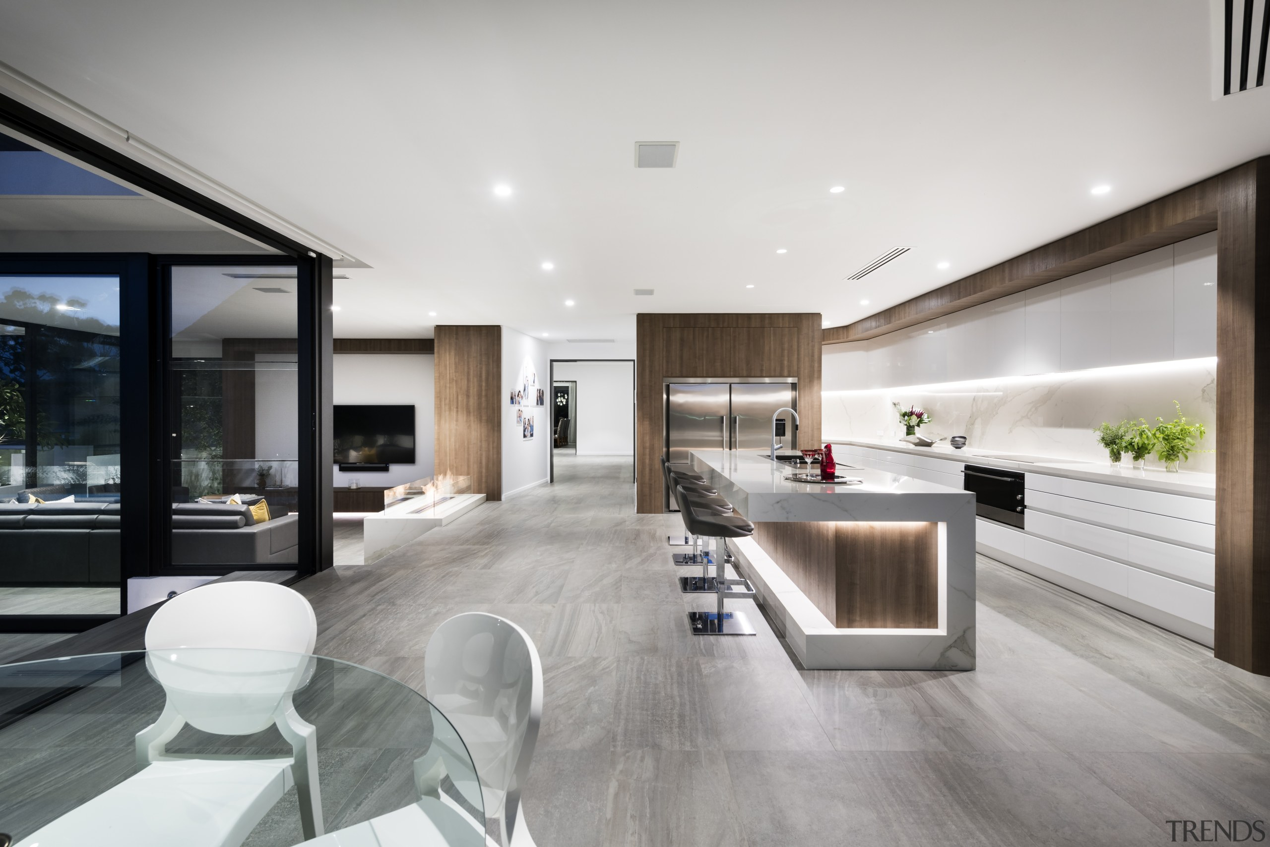 This two-tone kitchen with its natural-look surfaces and architecture, floor, house, interior design, kitchen, living room, real estate, gray