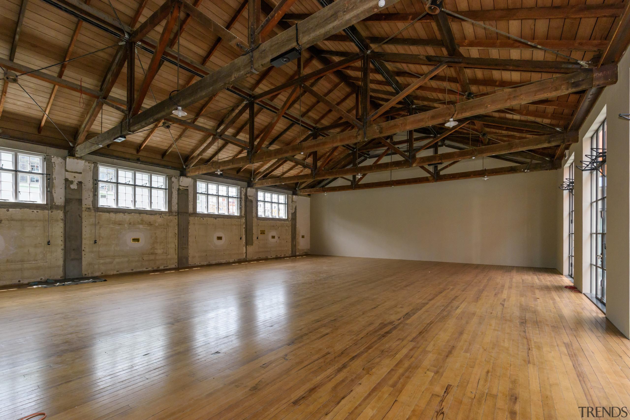 Work on the Orange Halls ground level Ballroom attic, floor, flooring, hardwood, loft, property, real estate, structure, wood, wood flooring, brown