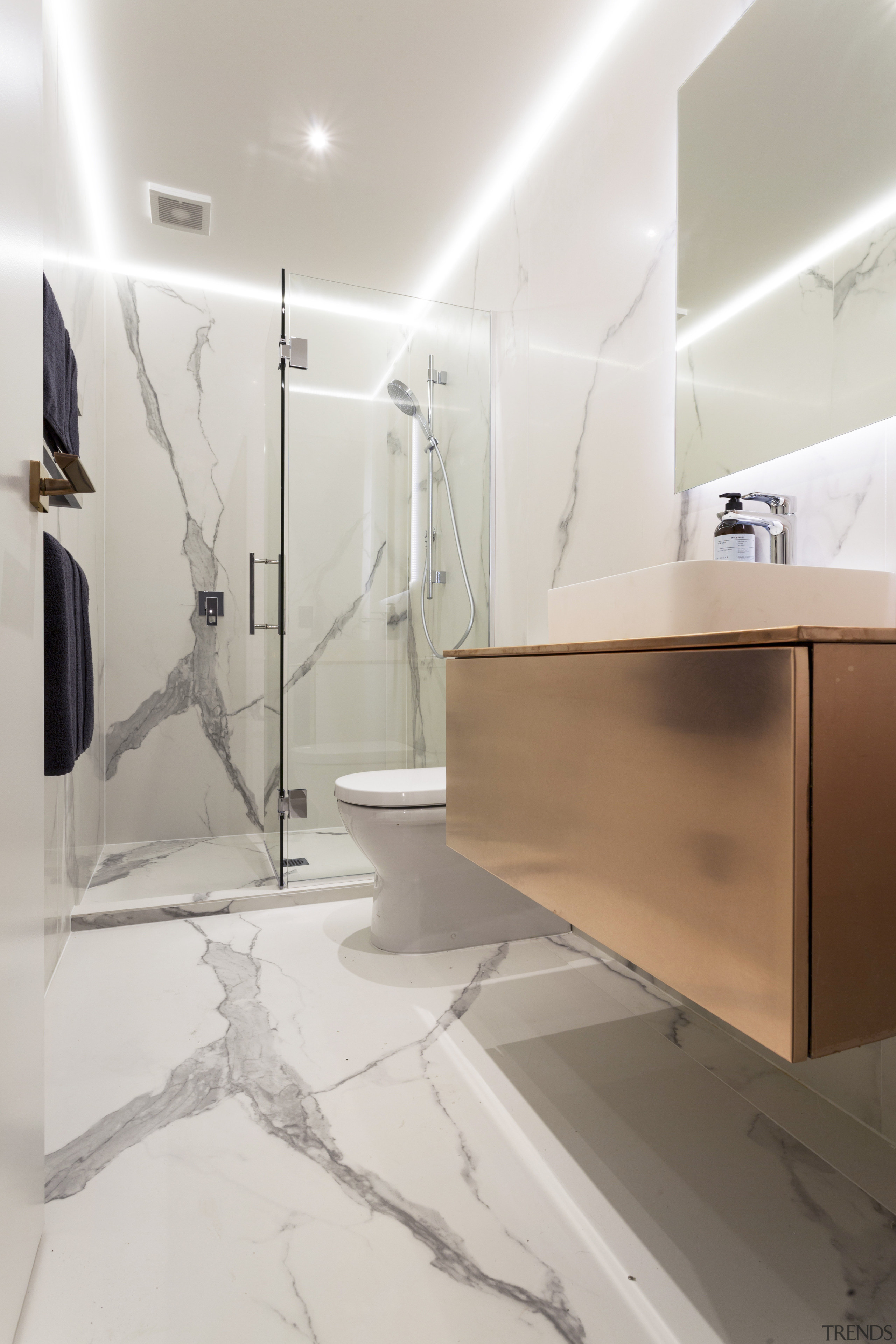 In all three bathrooms in this project, the bathroom, floor, flooring, interior design, plumbing fixture, product design, room, sink, tap, tile, wall, gray