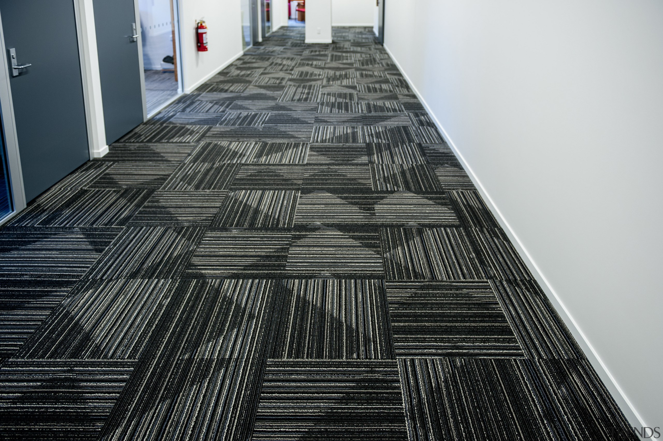 Durable, good-looking carpet tiles for commercial use.  architecture, building, daylighting, floor, flooring, line, structure, wood, black, white