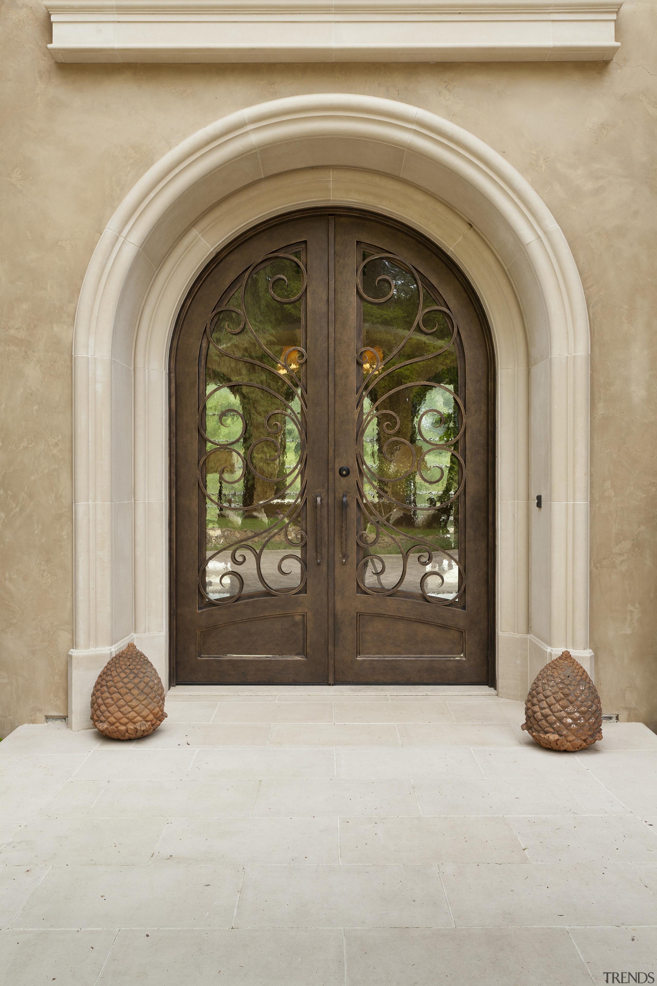 Decorative front door with limestone surround on Mediterranean-style arch, architecture, door, estate, home, window, gray, brown