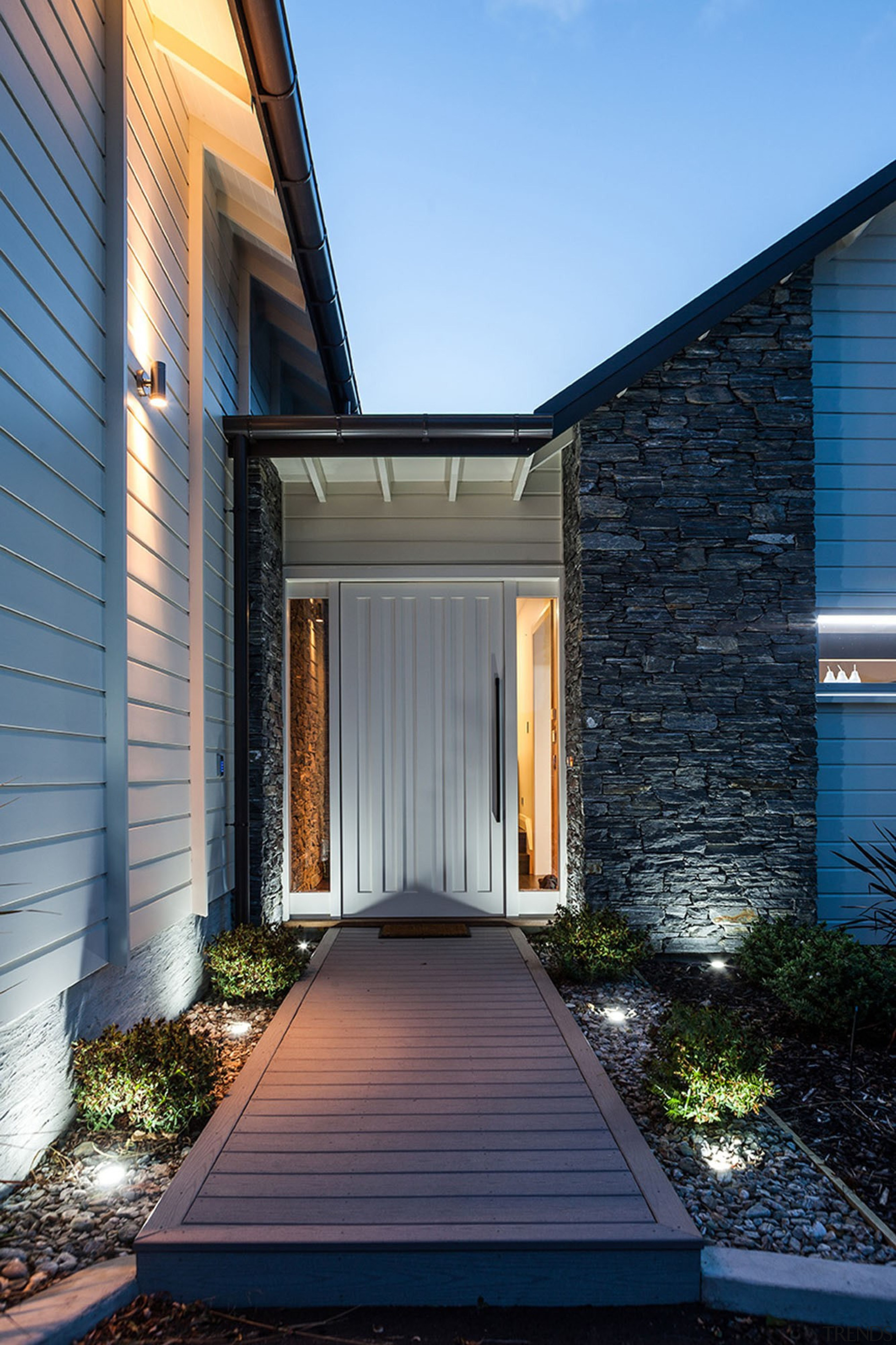 This home is stunning in so many ways. architecture, building, courtyard, estate, facade, home, house, property, real estate, residential area, siding, sky, window, black