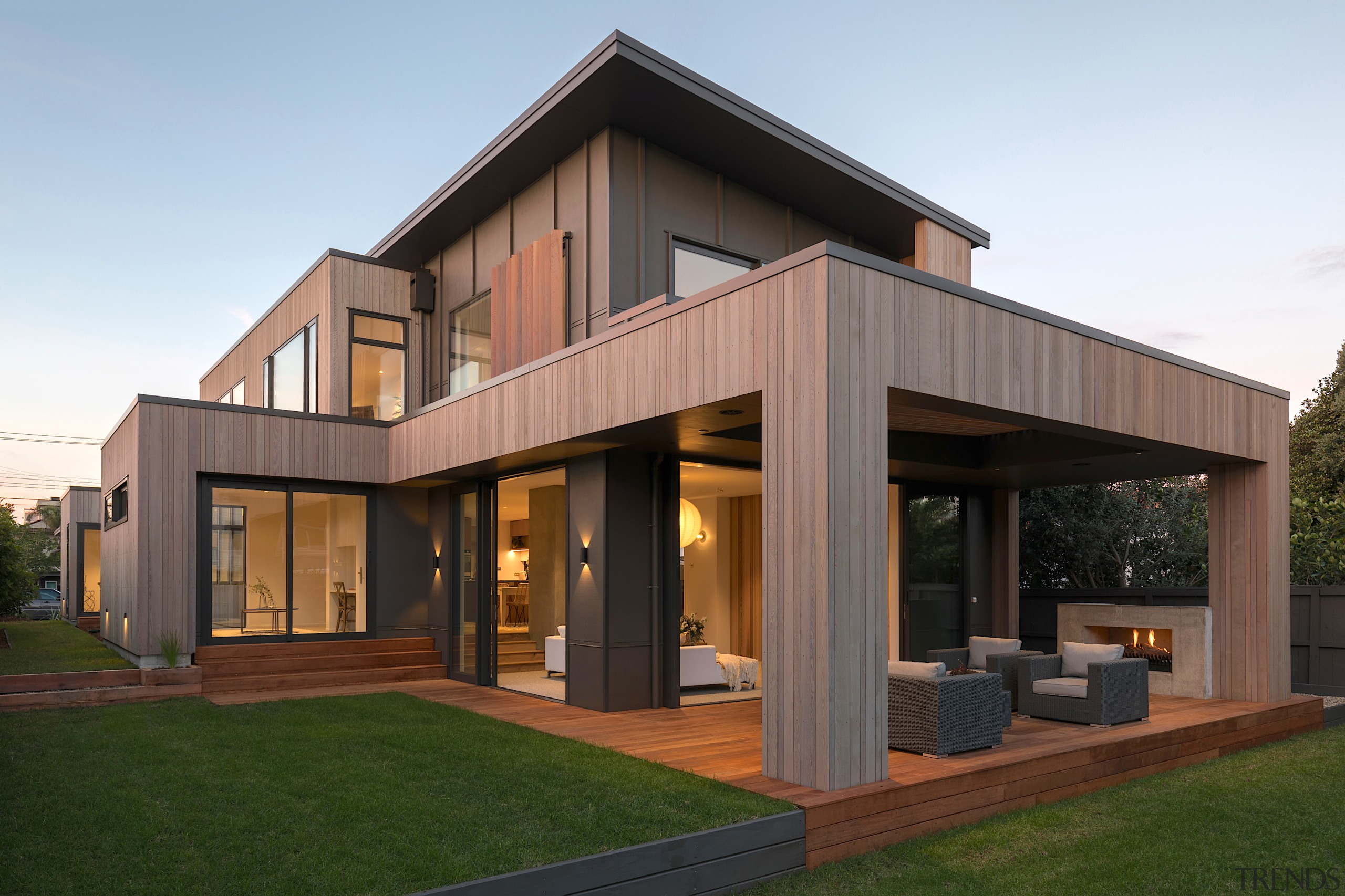 Cedar batons predominate on the home's clean-lined exterior.