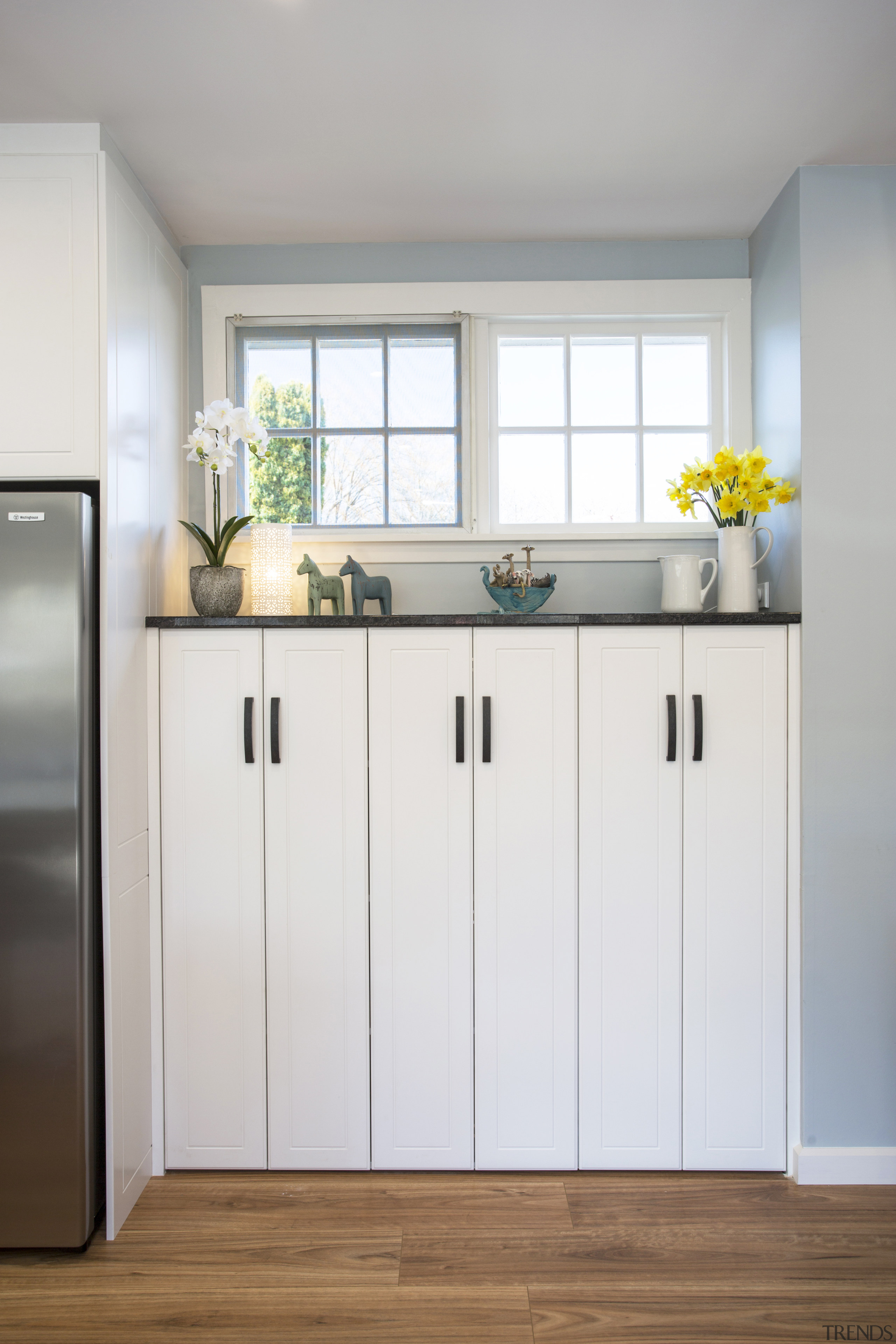 I wanted to showcase the extra high window cabinetry, floor, interior design, kitchen, product, room, white, gray