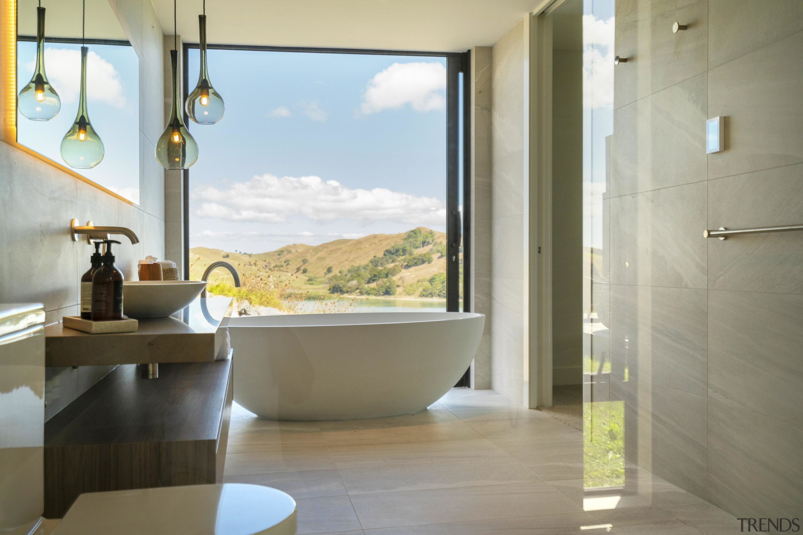 In this master ensuite blessed with spectacular views, gray