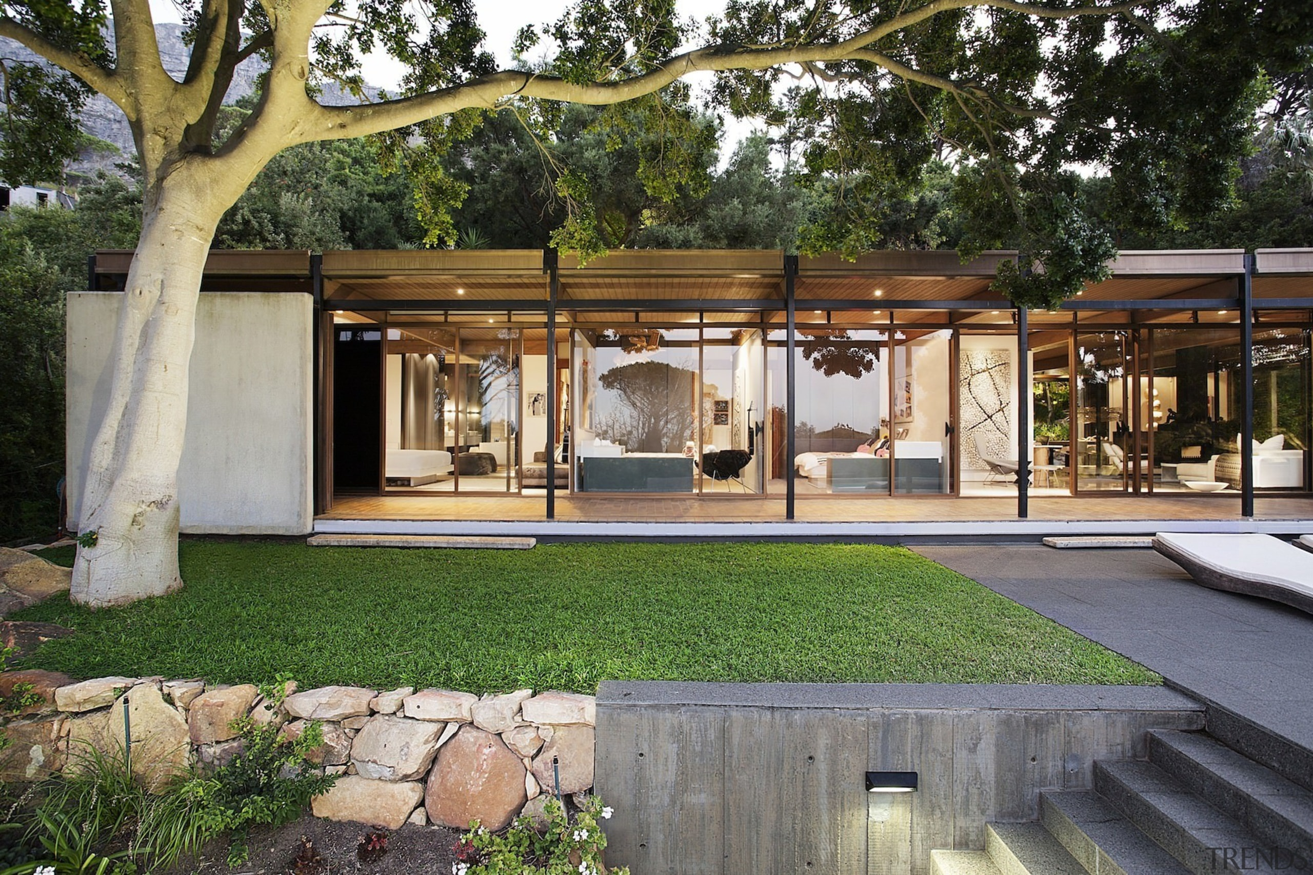 The tidy grounds perfectly match the home - architecture, backyard, courtyard, house, outdoor structure, real estate, gray