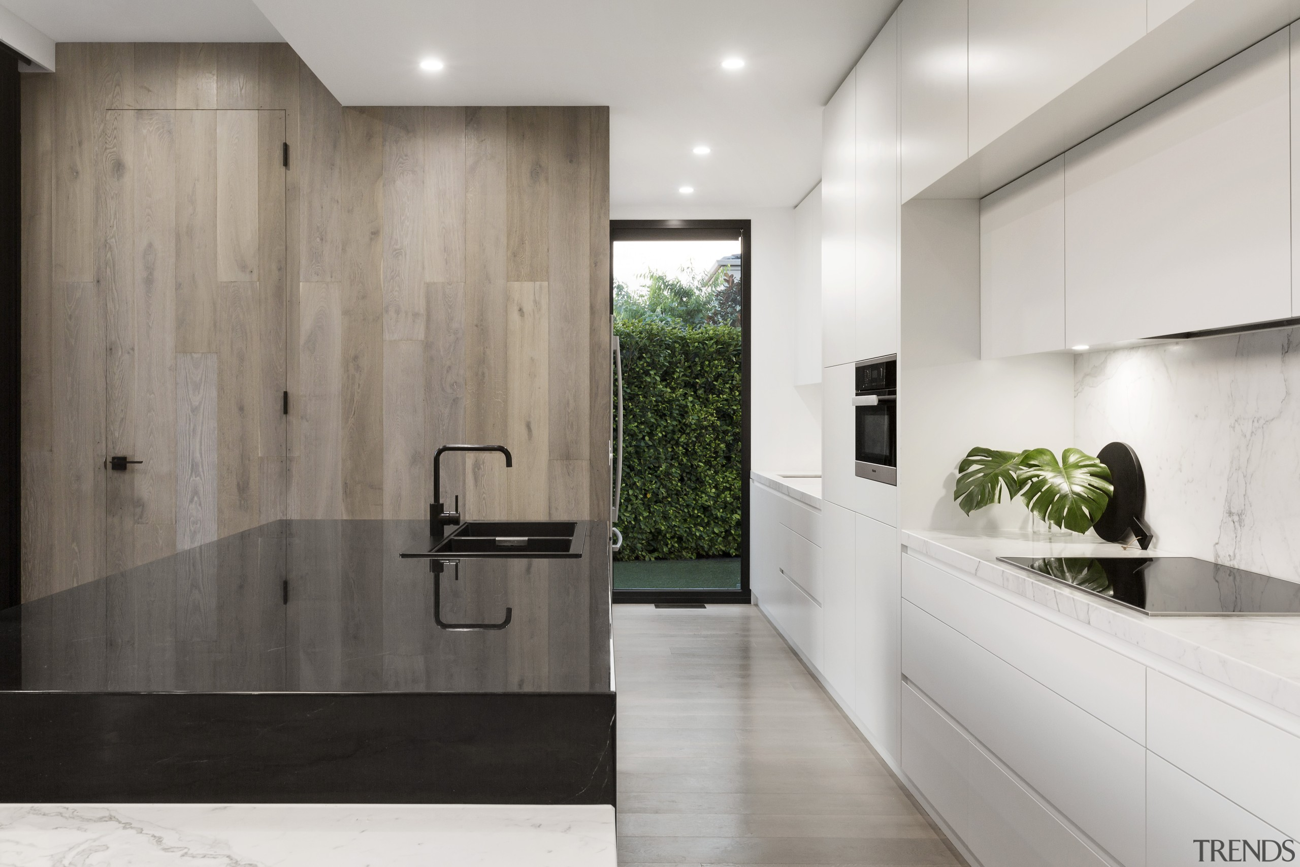 ​​​​​​​A walk-in pantry tucked behind a powder room architecture, countertop, floor, flooring, tiles, interior design, kitchen, sink, tile, LSA Architects
