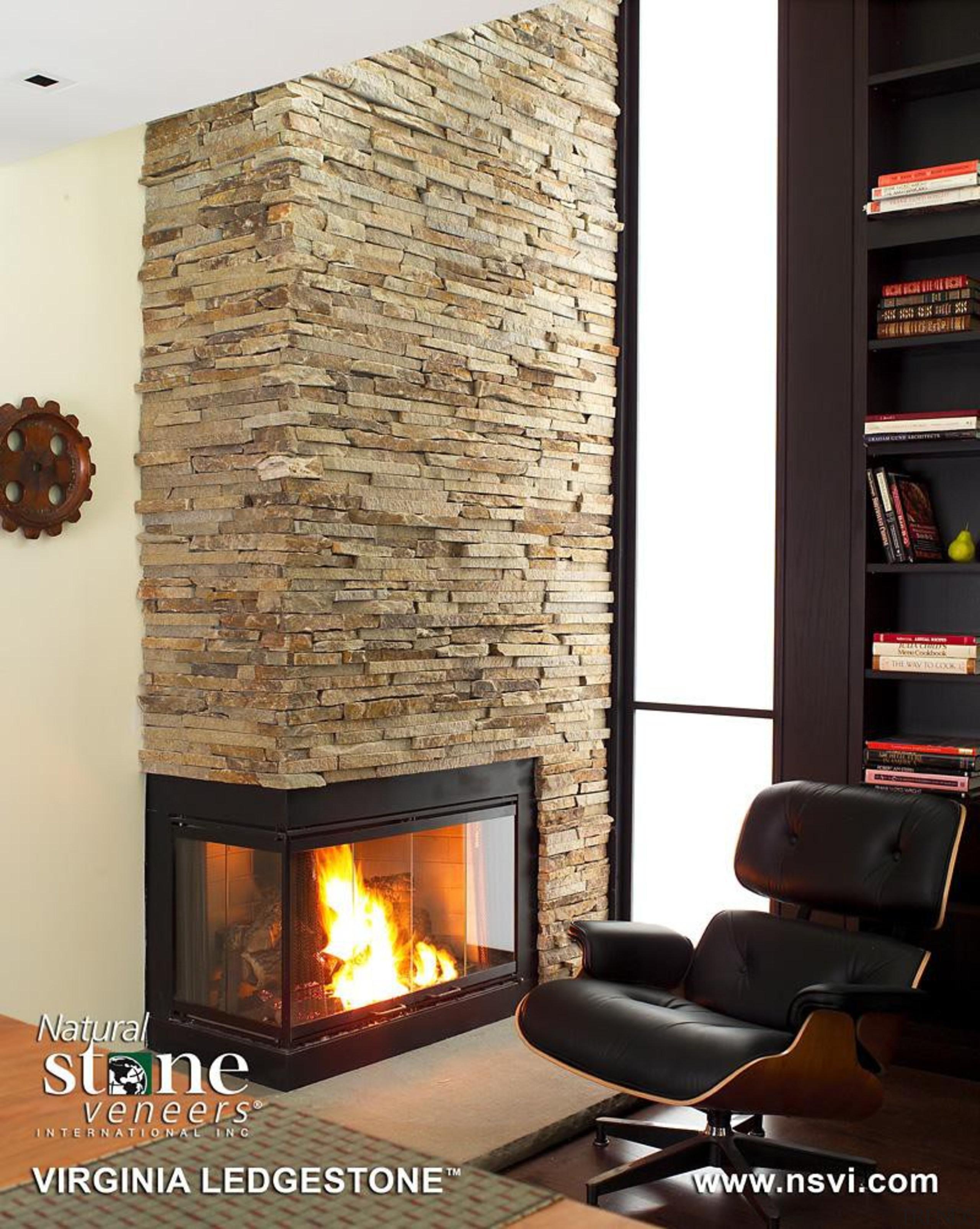 Frank Lloyd Wright renovation project in Cambridge, Massachusetts fireplace, hearth, heat, interior design, living room, wood burning stove, white, black