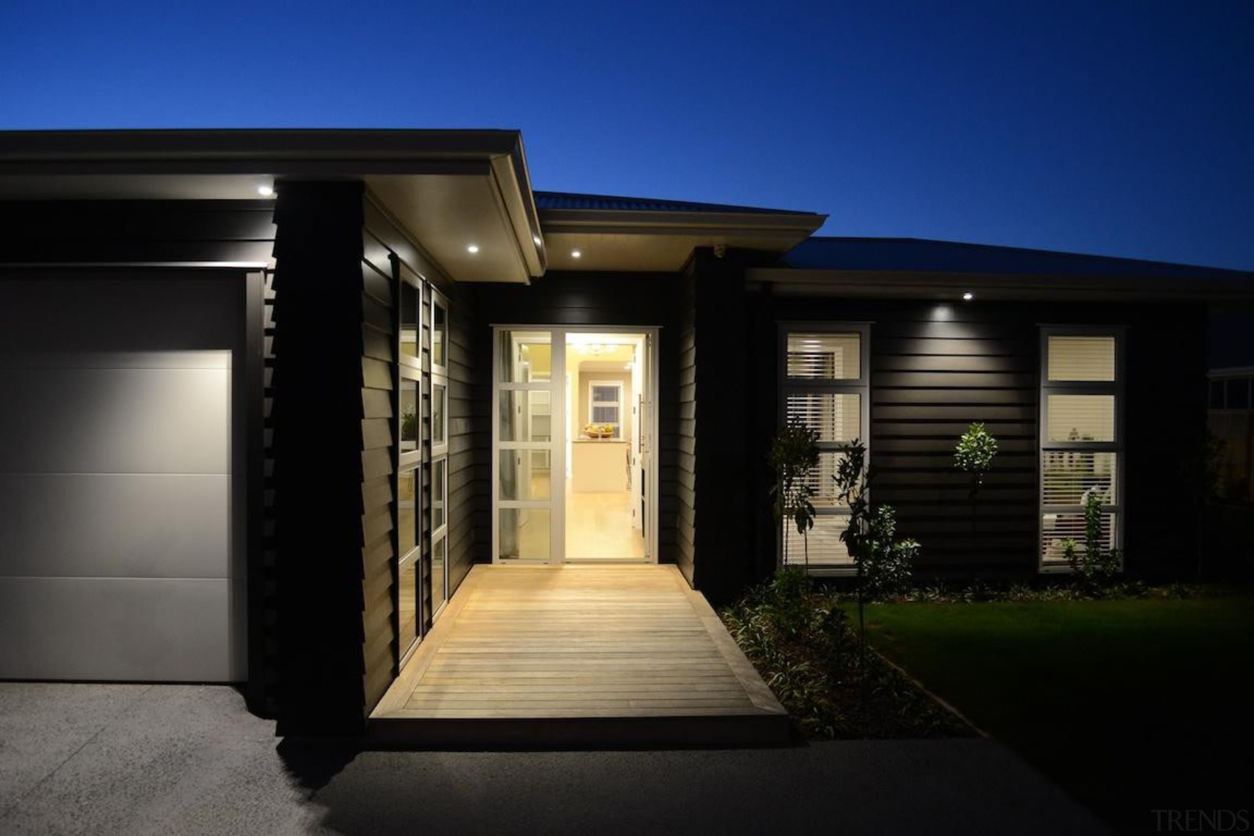 A timber board walk leads to the entry architecture, building, estate, facade, home, house, lighting, property, real estate, window, black