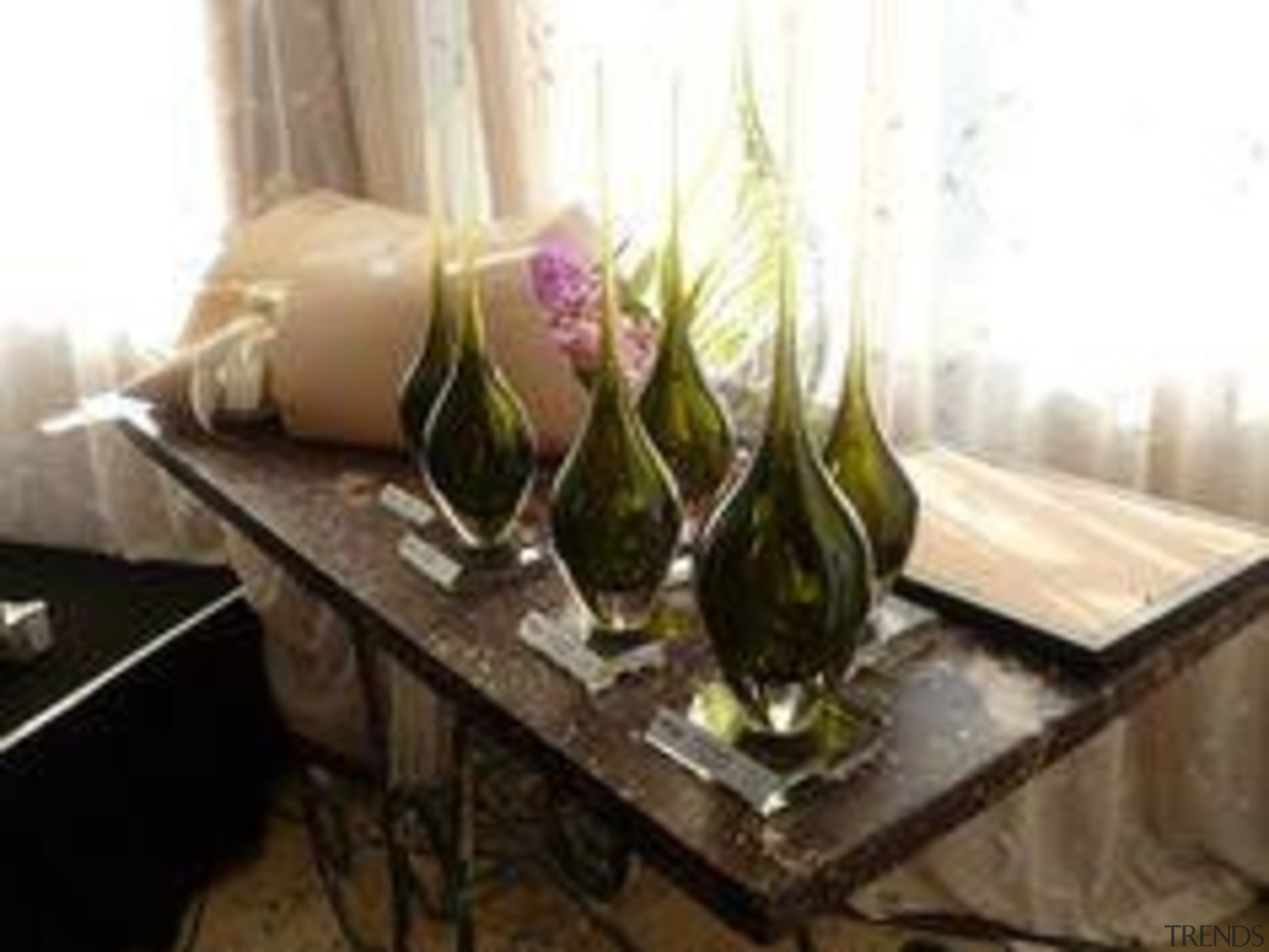 Trophies by glass artist Katie Brown and flowers floristry, furniture, glass, interior design, plant, property, stemware, still life, table, wine glass, white, black