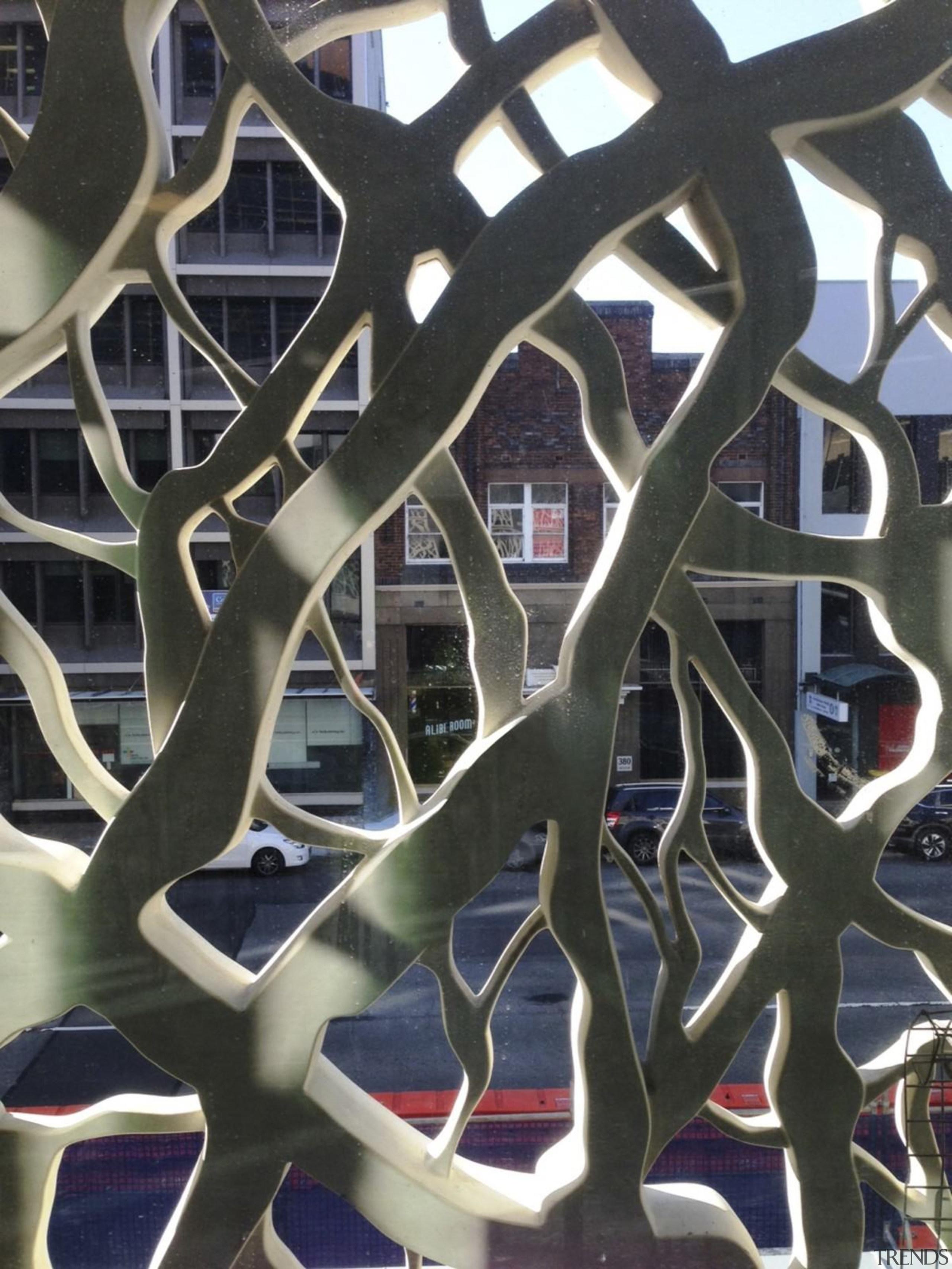 Newcastle Courthouse – Cox Architecture - Newcastle Courthouse iron, metal, pattern, spoke, wheel, black