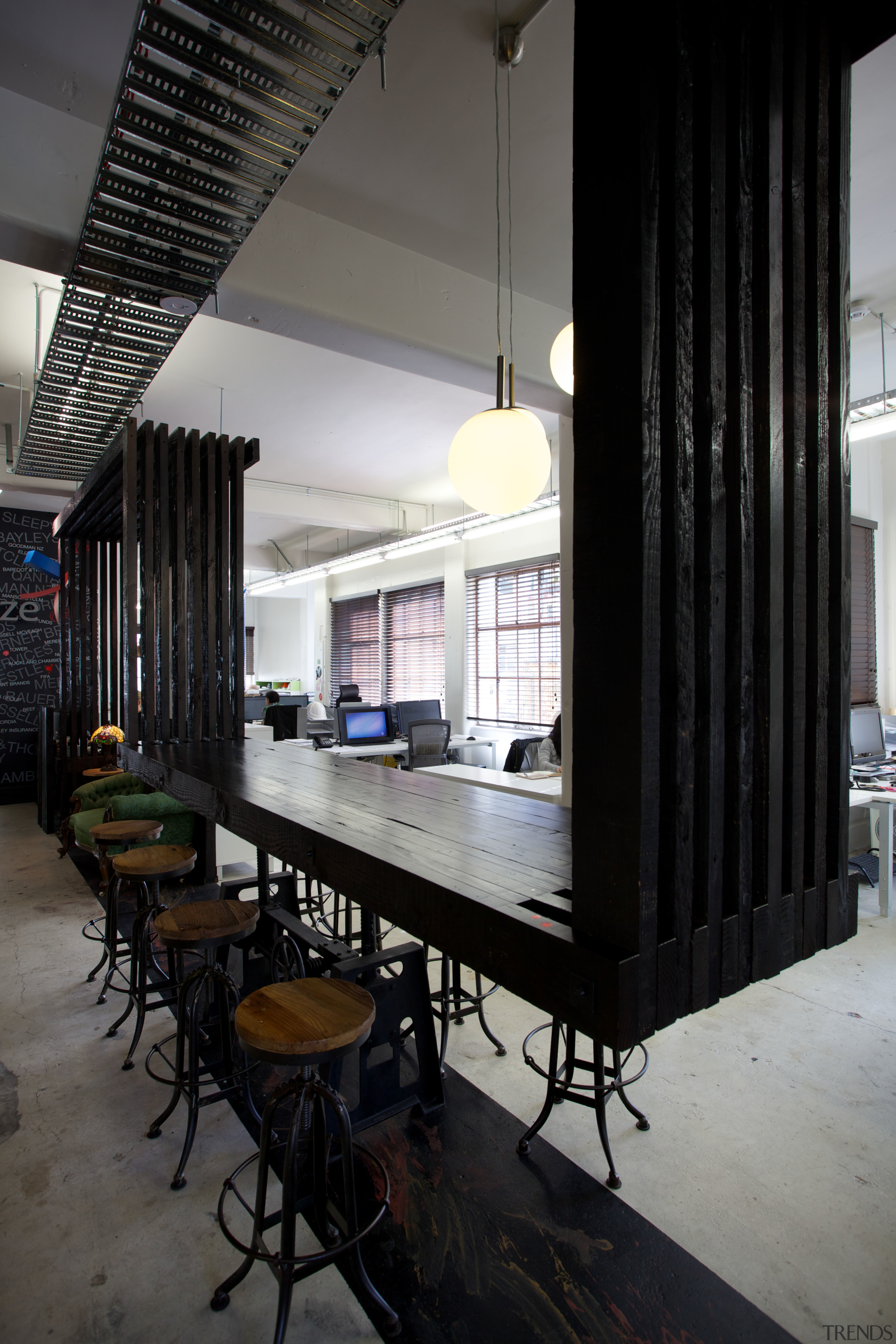 A rough-sawn timber spine runs the length of furniture, interior design, table, black, gray