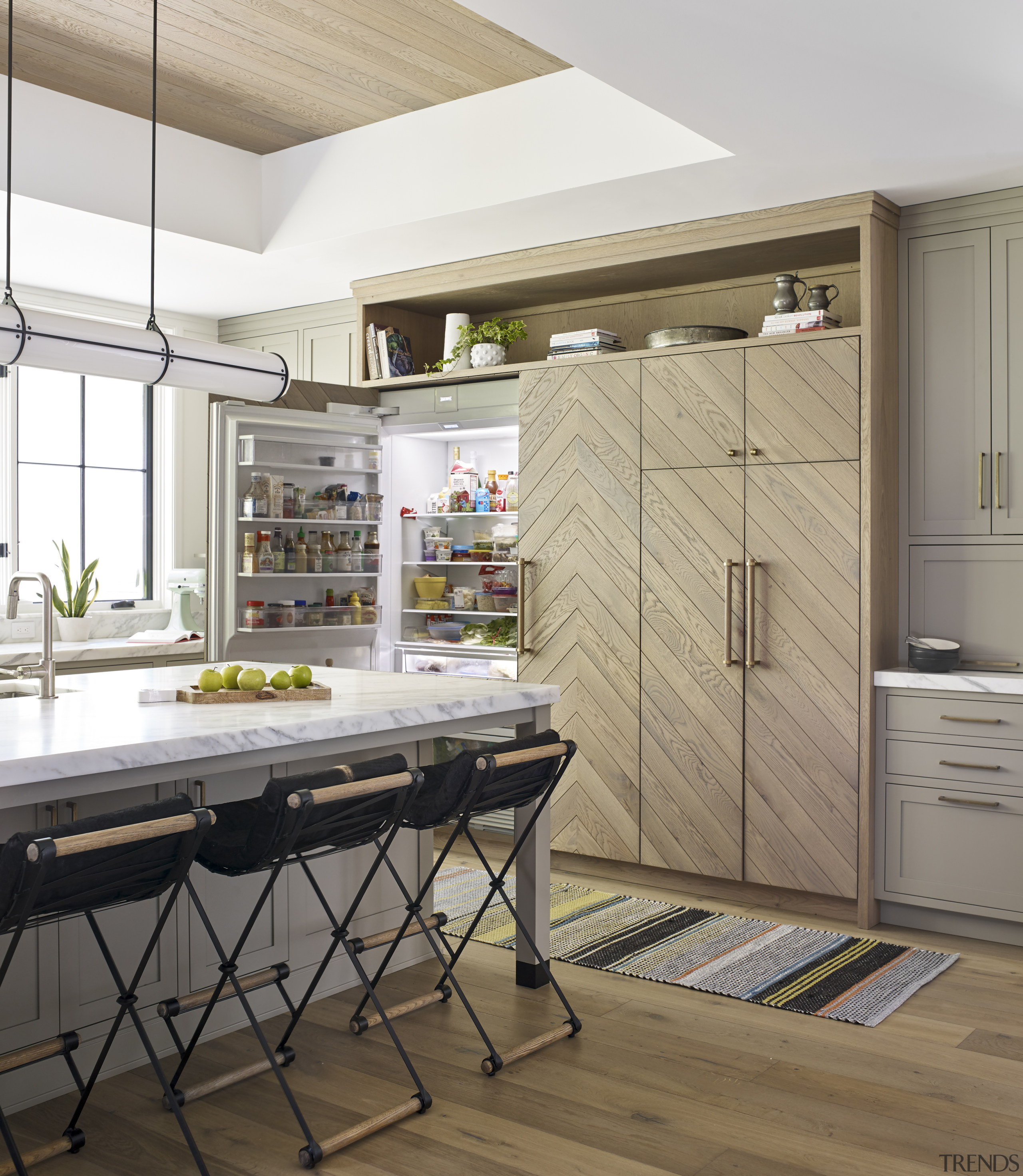 Oh, there's the fridge. This chevron-pattern fronted cabinet