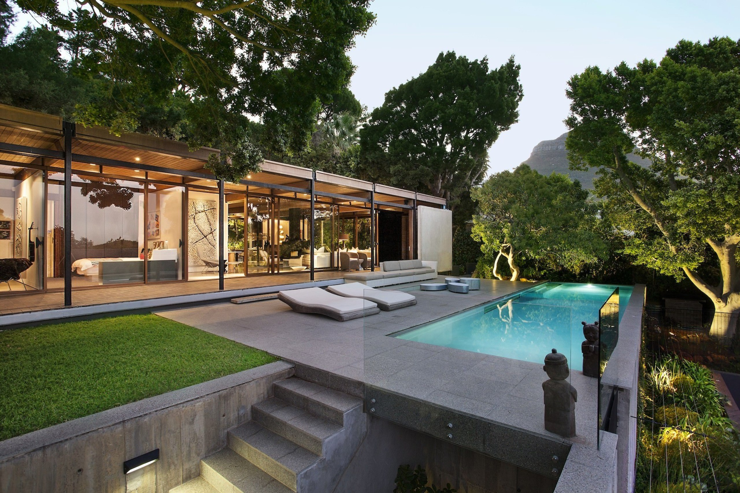 Dive into the elegant pool, before drying off architecture, backyard, estate, home, house, leisure, outdoor structure, property, real estate, resort, swimming pool, villa, brown