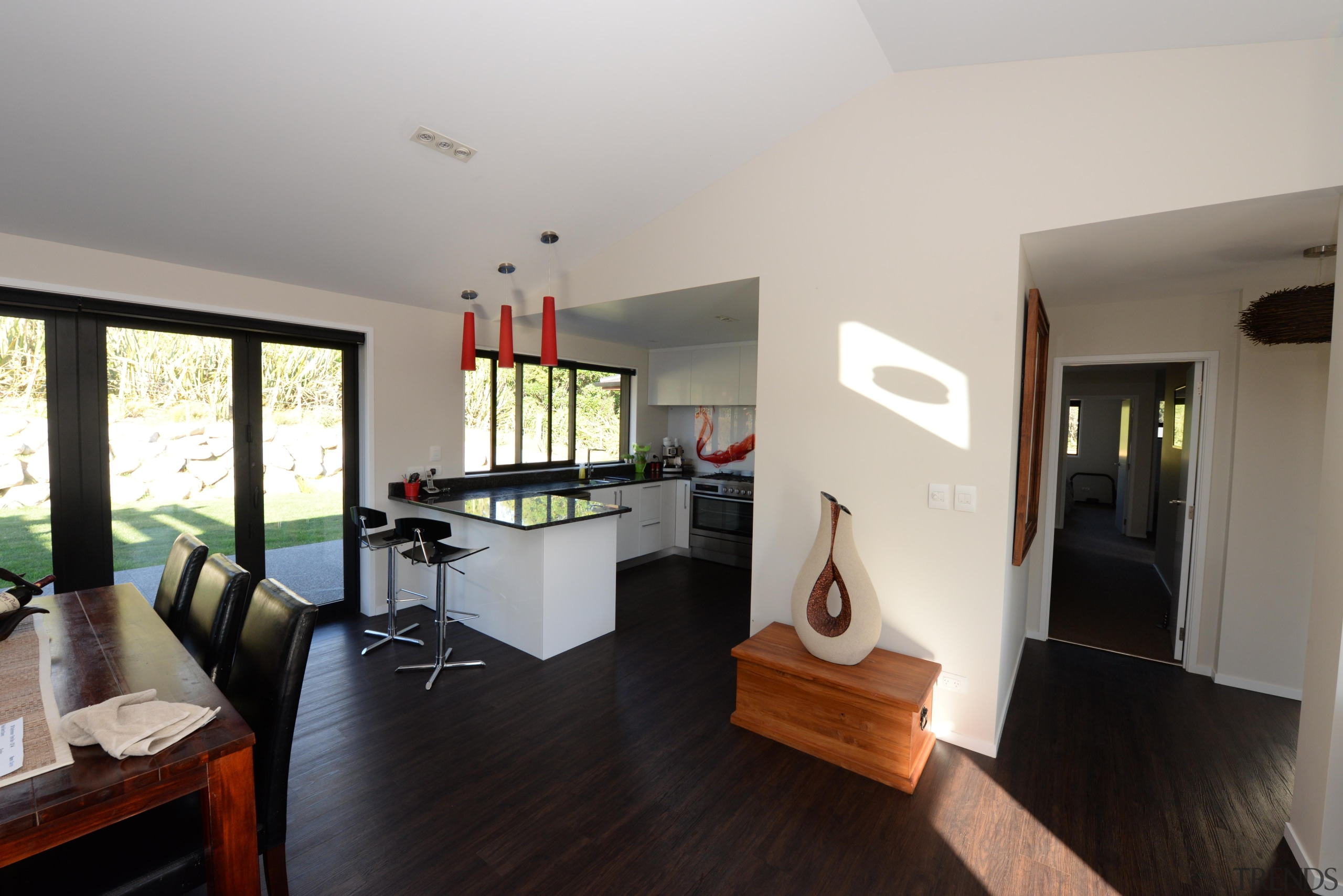 This home is built by Fowler Homes Taranaki floor, flooring, house, interior design, living room, property, real estate, room, gray, black