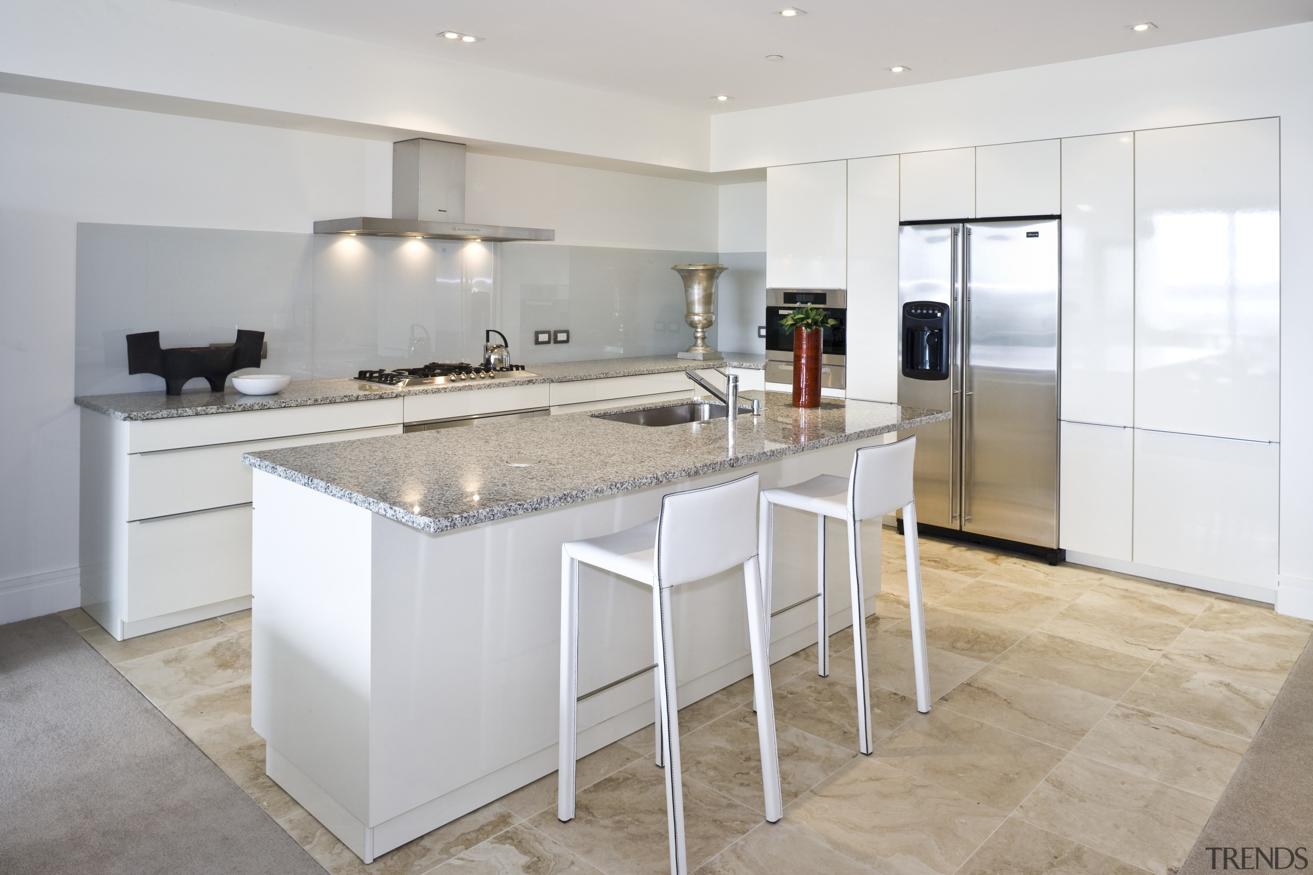 View of apartment kitchen with tiled flooring, kitchen cabinetry, countertop, cuisine classique, floor, interior design, kitchen, property, real estate, room, gray, white